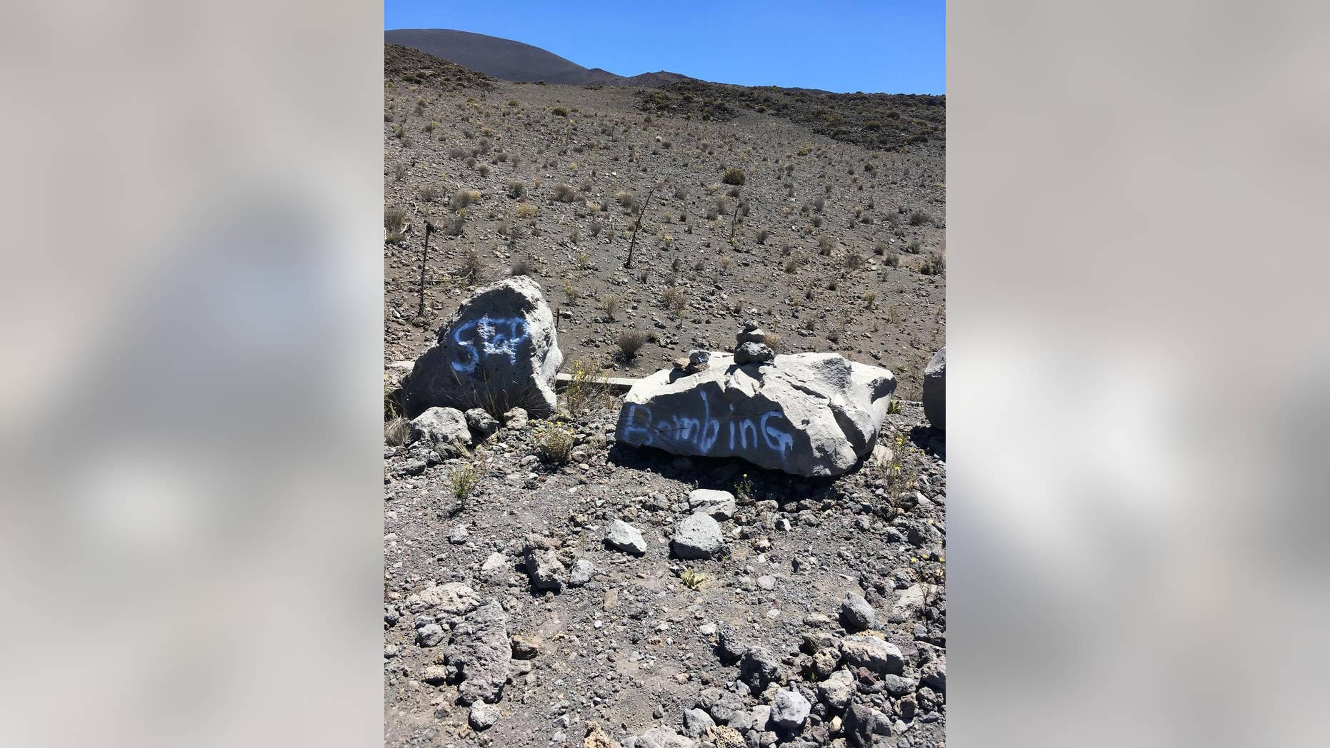 This undated photo provided by the Hawaii Department of Land and Natural Resources shows graffiti within a protected area on one of Hawaii's most revered mountains in the Mauna Kea Ice Age Reserve. The department said the graffiti was found on April 28, 2017, and authorities are asking for the public's help in finding out who painted the graffiti. (Hawaii Department of Land and Natural Resources via AP)