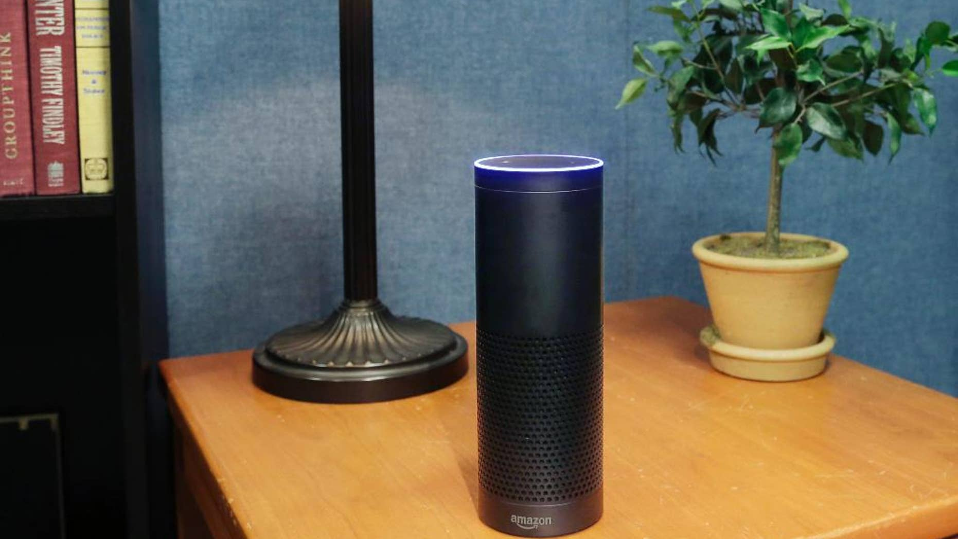 FILE - This July 29, 2015, file photo made in New York shows Amazon's Echo, a digital assistant that continually listens for commands such as for a song, a sports score or the weather. (AP Photo/Mark Lennihan, File)