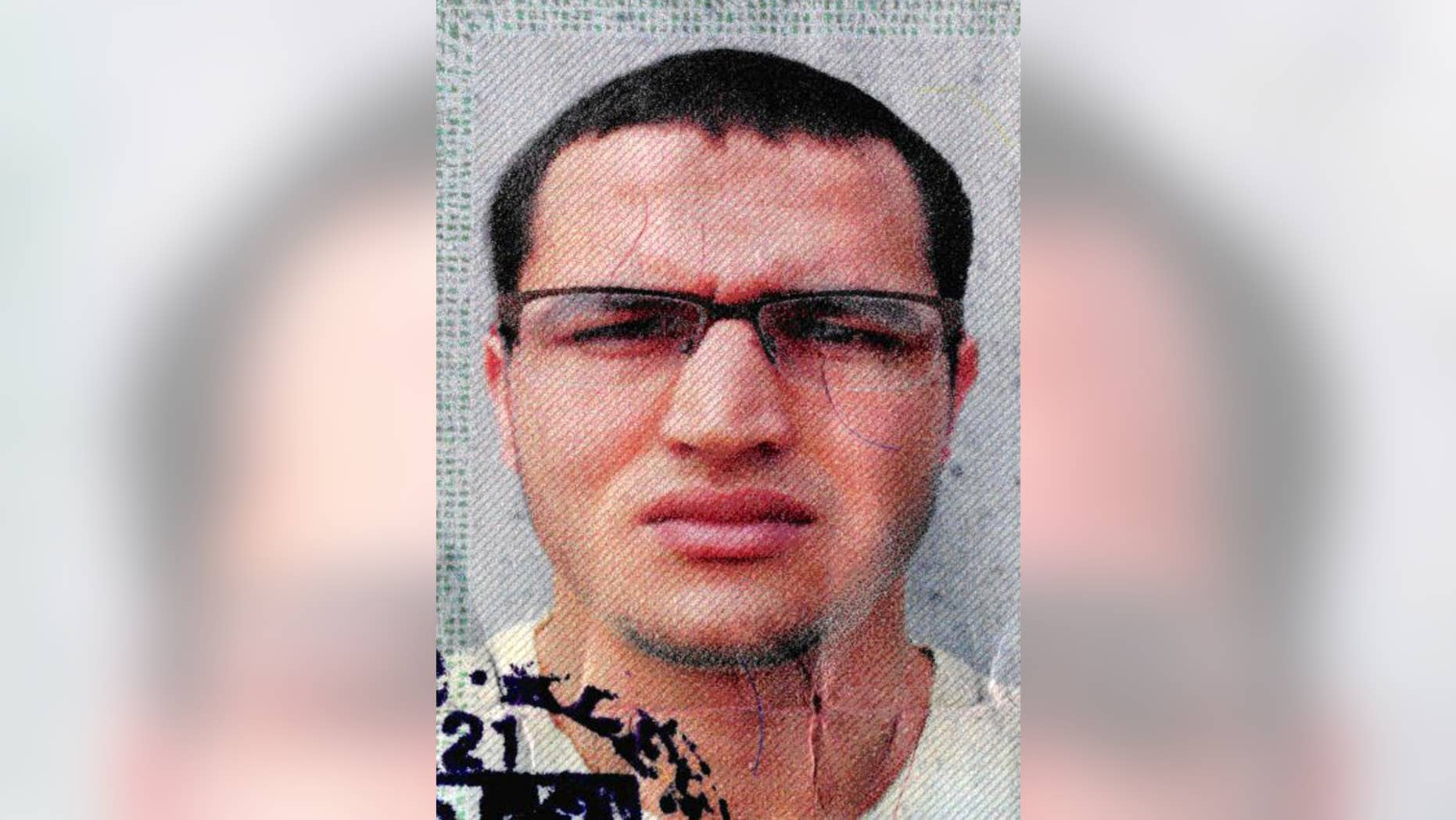 The photo issued by German federal police on Wednesday, Dec. 21, 2016 shows 24-year-old Tunisian Anis Amri on a photo that was used on the documents found in the truck. He is suspected of being involved in the fatal attack on the Christmas market in Berlin on Dec. 19, 2016. German authorities are offering a reward of up to 100,000 euros (US$ 105,000) for the arrest of the Tunisian. (German police via AP)