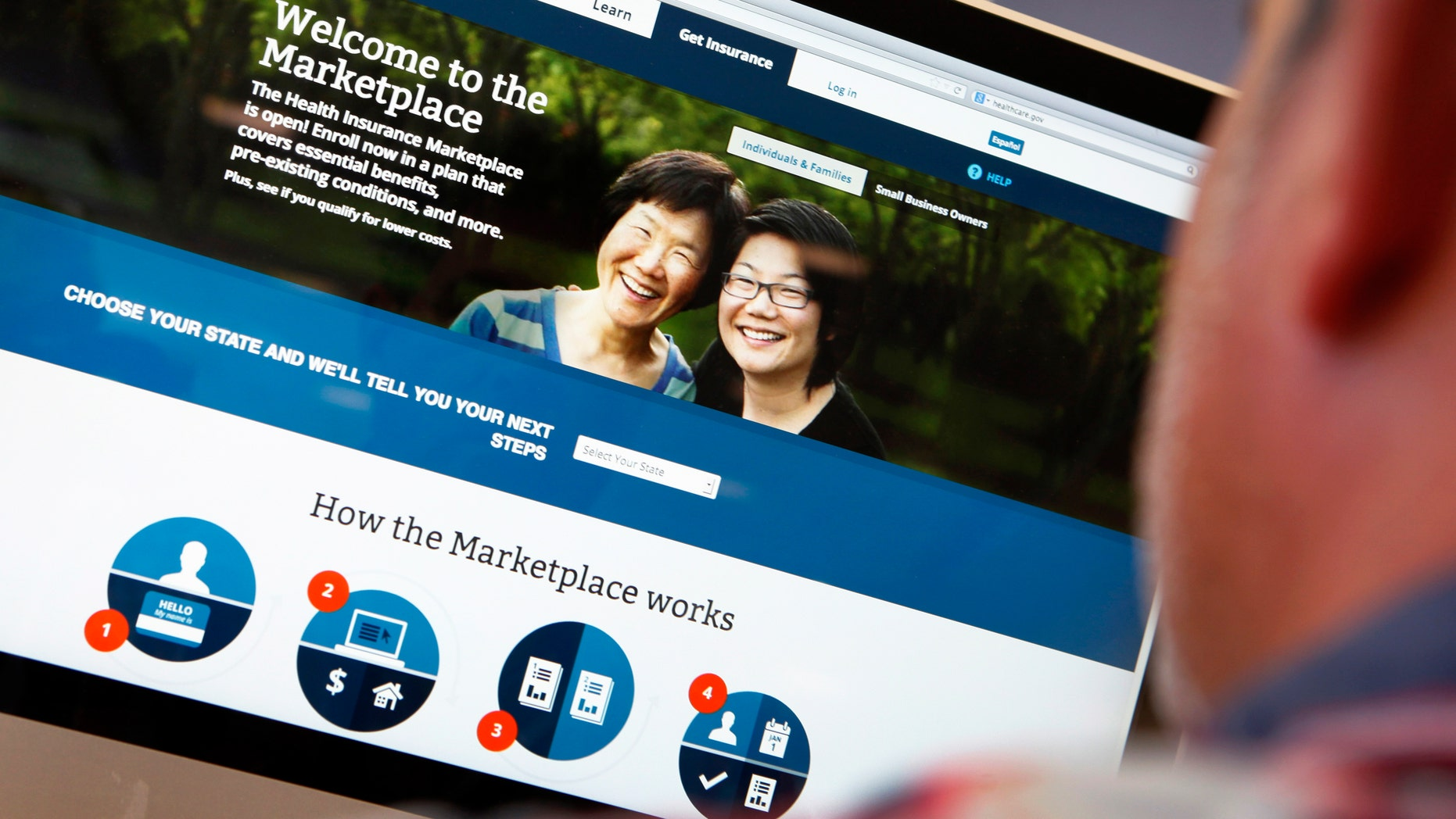 Oct. 2, 2013: A man looks over the Affordable Care Act signup page on the HealthCare.gov website in New York in this photo illustration.