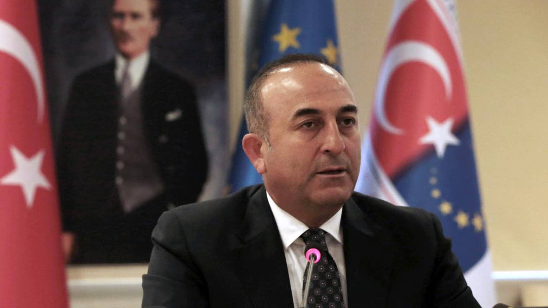 """This is an image taken Wednesday May 4, 2016  of Turkish Foreign Minister Mevlut Cavusoglu speaks during a news conference in Ankara, Turkey. Turkey has hailed the European Union executive Commission's recommendation to grant Turkish citizens the right to travel to Europe without visas as """"a new page"""" in relations between Turkey and the EU. (AP Photo/Burhan Ozbilici, File)"""