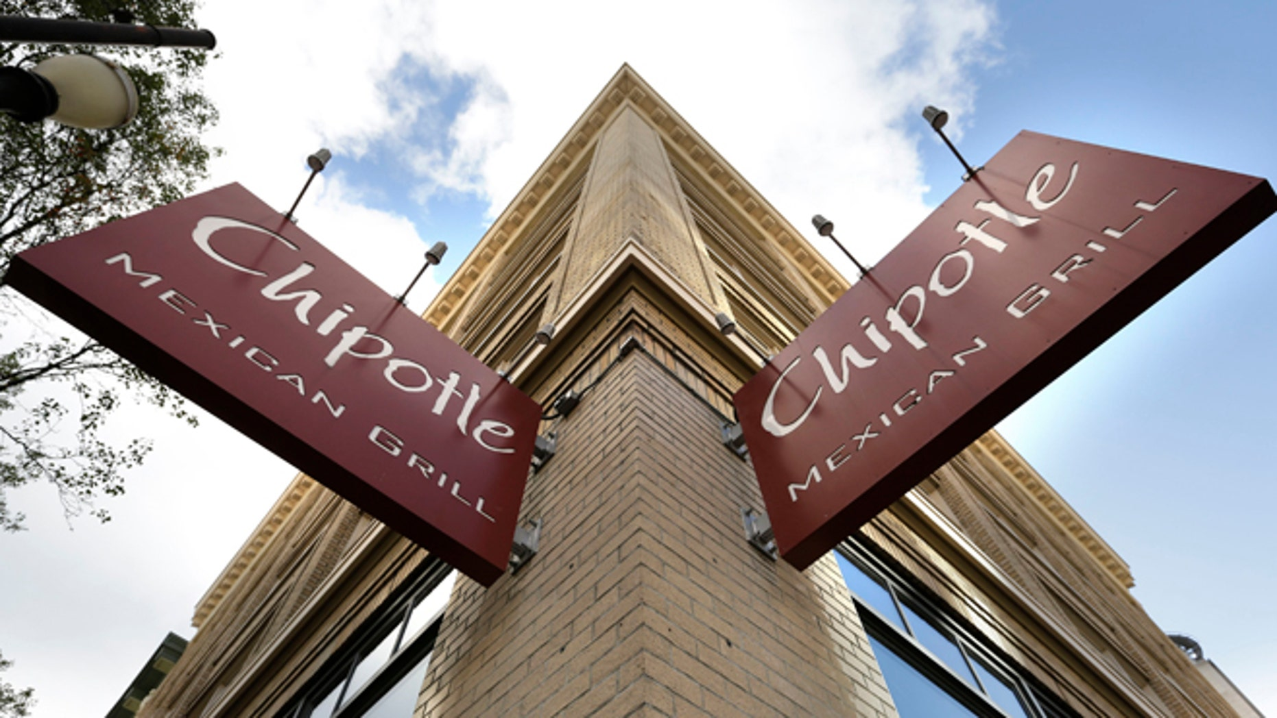 Signage hangs from a closed Chipotle restaurant in Portland, Ore., Monday, Nov. 2, 2015. Chipotle voluntarily closed down 43 of its locations in Washington and the Portland area as a precaution after an E. coli outbreak linked to six of its restaurants in the two states has sickened nearly two dozen people. (AP Photo/Don Ryan)
