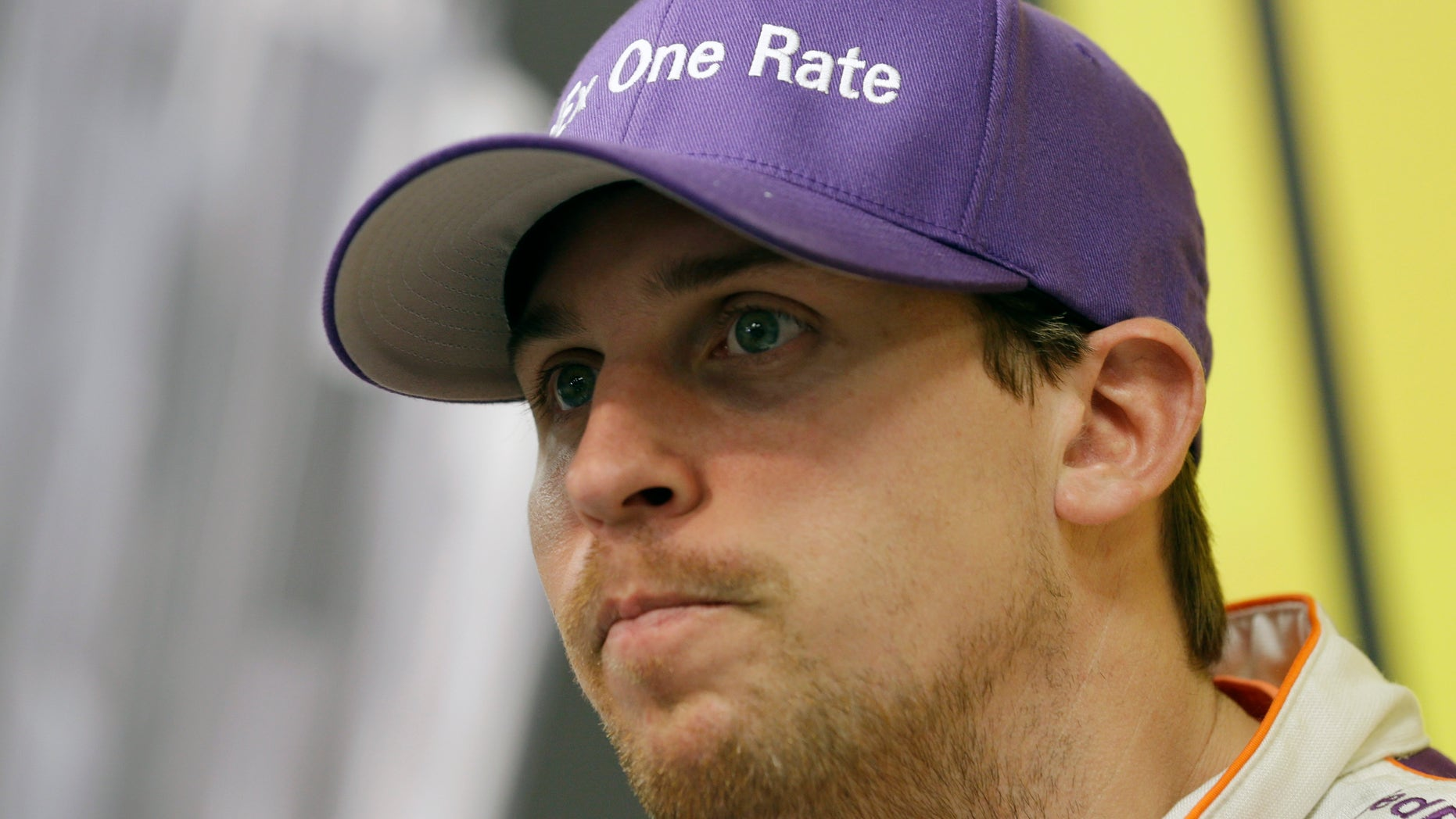 NASCAR Sprint Cup series driver Denny Hamlin talks to the media after practice for Sunday's auto race at the Martinsville Speedway in Martinsville, Va., Friday, Oct. 25, 2013. (AP Photo/Steve Helber)