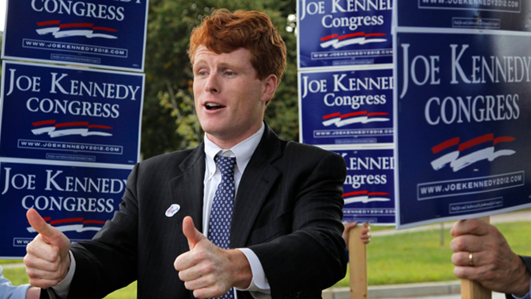 Joseph Kennedy III, son of former U.S. Rep. Joseph P. Kennedy II and grandson of the late Robert F. Kennedy gestures while visiting voters outside a polling station at a school in Needham, Mass., Thursday, Sept. 6, 2012. The 31-year-old Kennedy is vying for the House seat being vacated by Democratic U.S. Rep. Barney Frank. (AP Photo/Steven Senne)