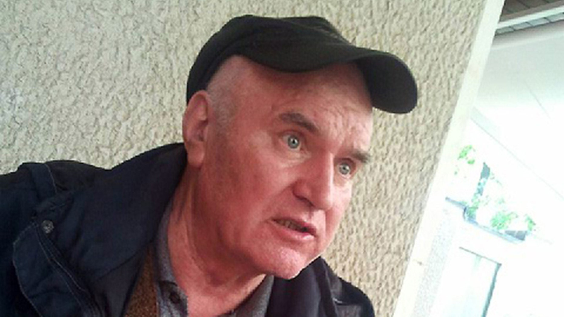 In this photo provided by Press newspaper, the Bosnian Serb army commander Ratko Mladic is seen at an undisclosed location at an unknown time after his arrest in Serbia after years in hiding.