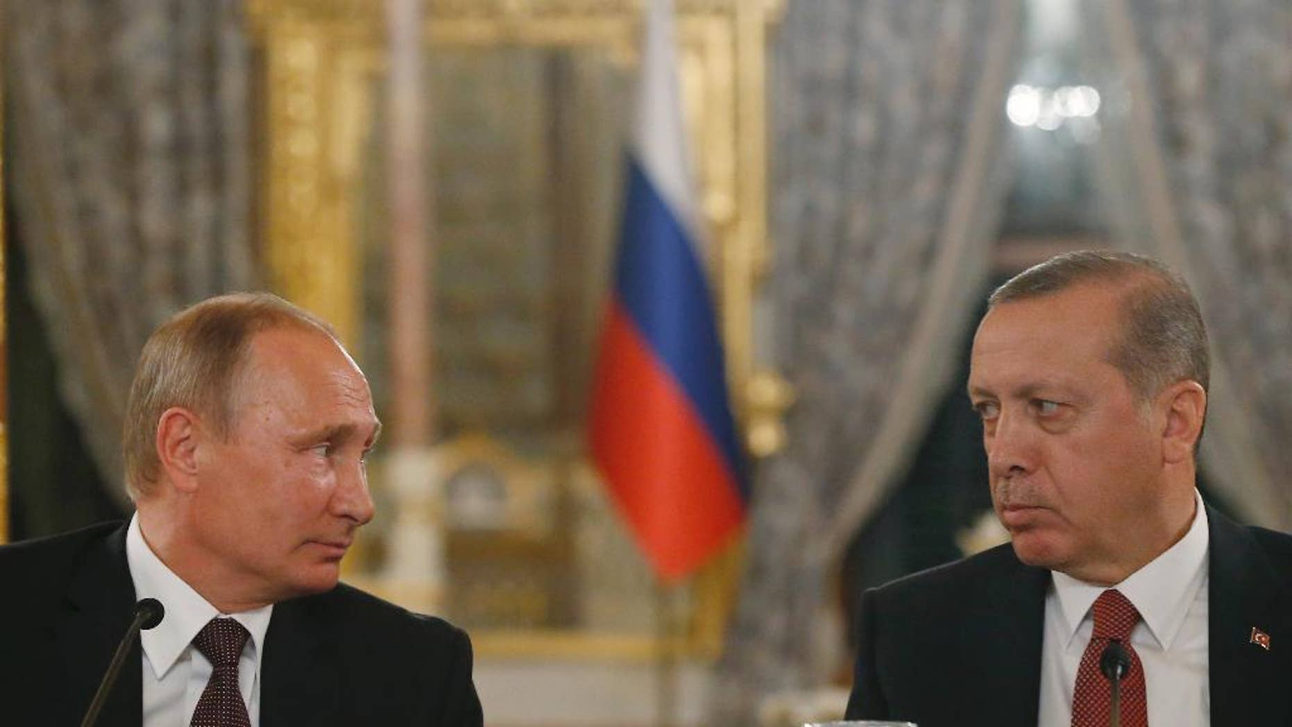 Turkey's President Recep Tayyip Erdogan, right and Russian President Vladimir Putin, left, look at each other during a news conference following their meeting in Istanbul, Monday, Oct. 10, 2016. Putin and Erdogan voiced support for the construction of a gas pipeline from Russia to Turkey, called Turkish Stream, a project that was suspended amid tensions between the two countries. The pipeline would carry Russian natural gas to Turkey and onto European Union countries. (AP Photo/Emrah Gurel)
