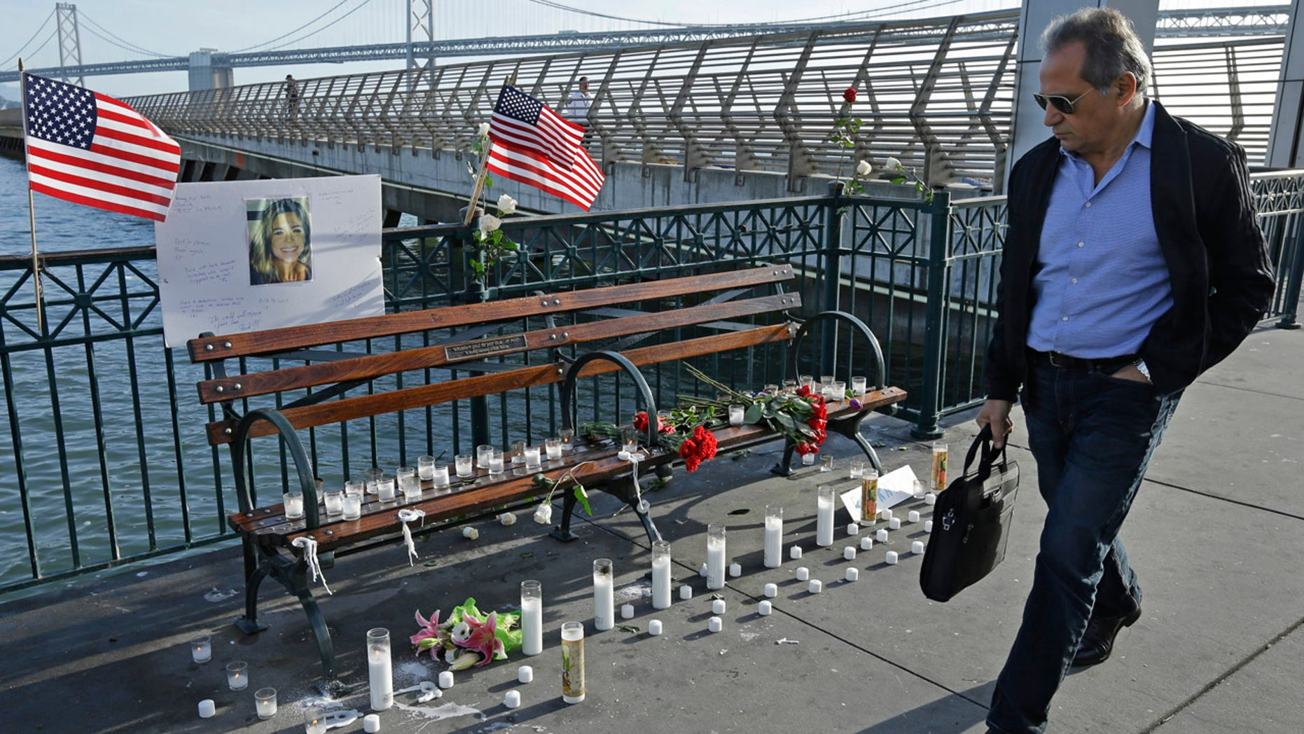 Dec. 1: A pedestrian passes the memorial to Kate Steinle at Pier 14 in San Francisco. The city reportedly removed the candles at Steinle's family's request.