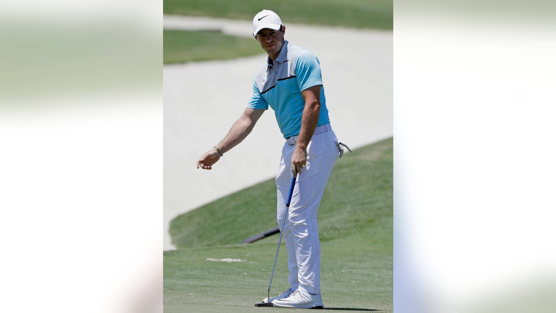 Rory McIlroy, of Northern Ireland, gestures after missing a birdie putt on the seventh green during the second round of The Players Championship golf tournament Friday, May 12, 2017, in Ponte Vedra Beach, Fla. (AP Photo/Chris O'Meara)
