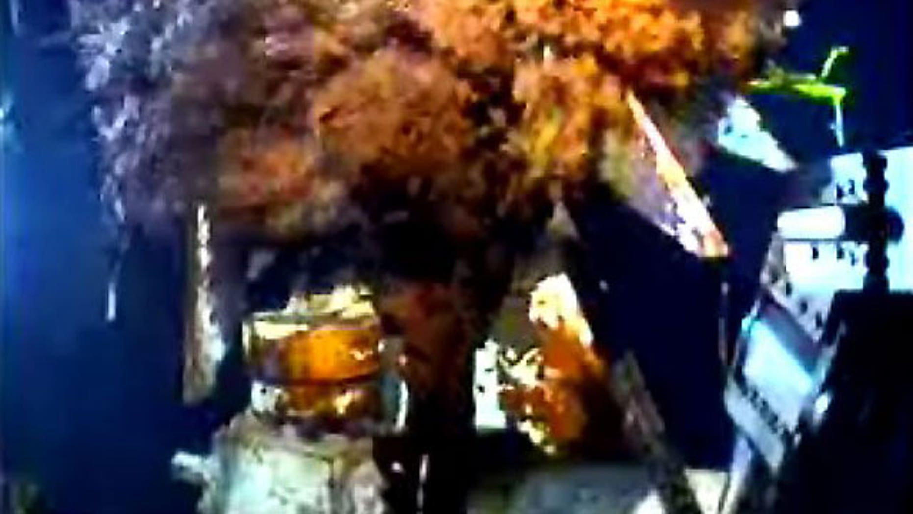 June 23, 2010:  This image from video provided by BP shows oil gushing from the broken wellhead at the site of the Deepwater Horizon oil well in the Gulf of Mexico.