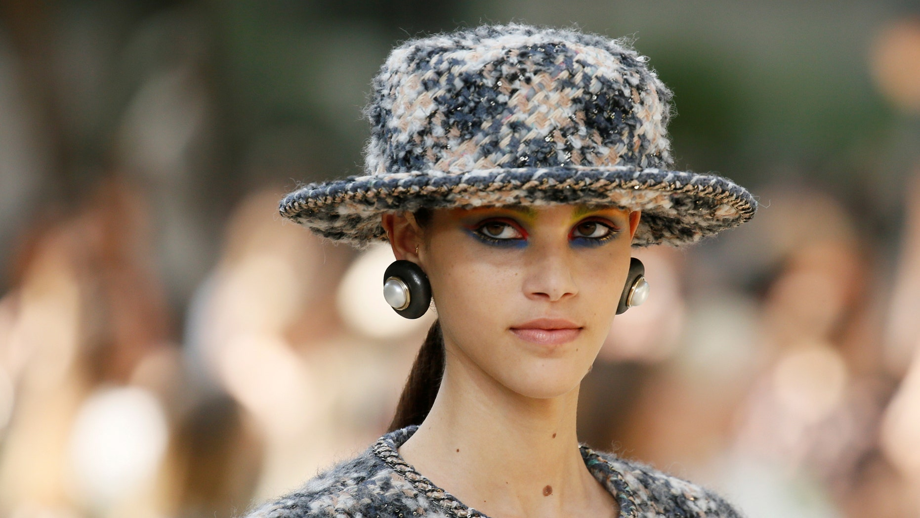 File photo: A model presents a creation by German designer Karl Lagerfeld as part of his Haute Couture Fall/Winter 2017/2018 collection for fashion house Chanel in Paris, France, July 4, 2017. (REUTERS/Gonzalo Fuentes)