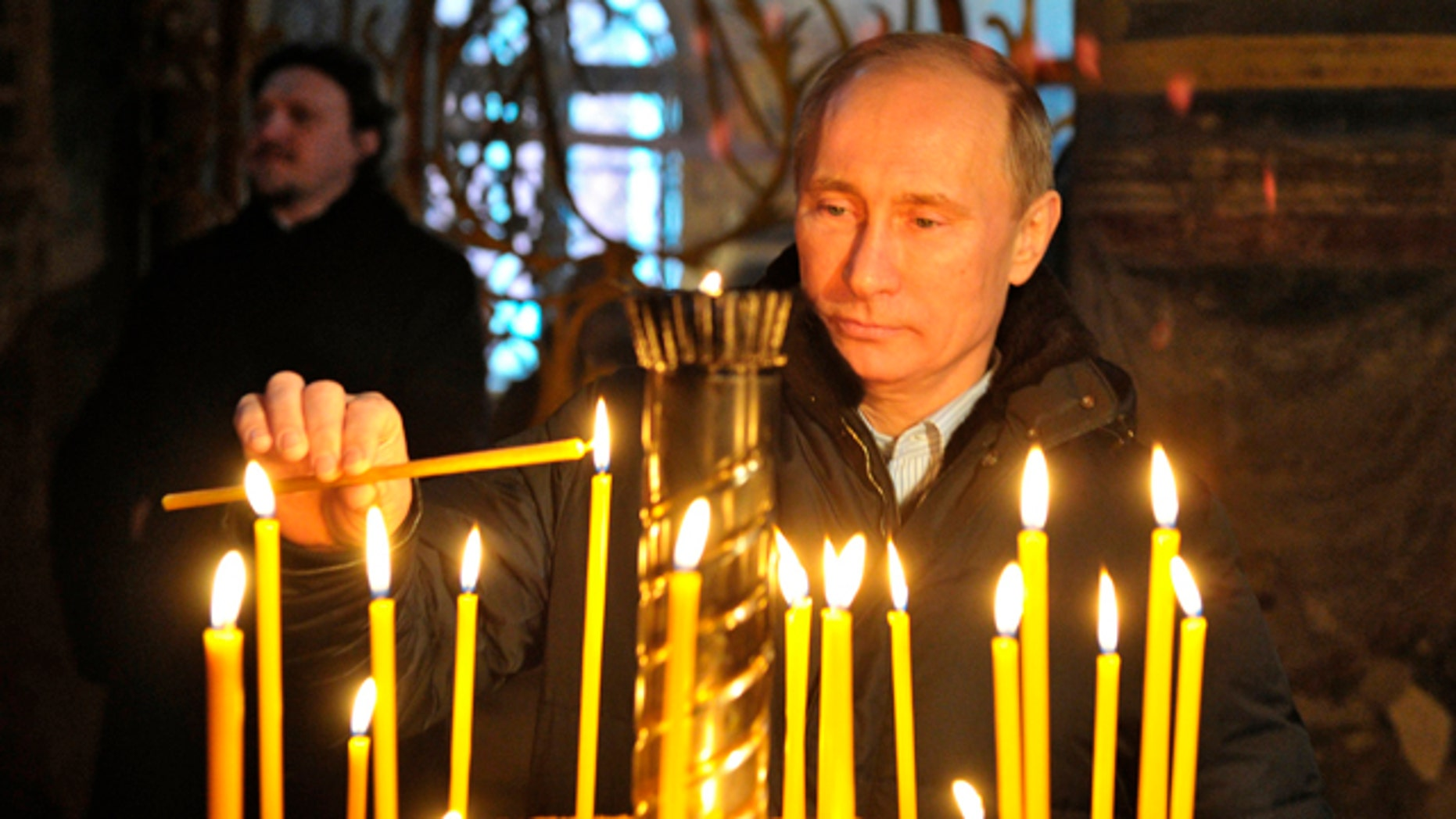 Jan. 30: Russian Prime Minister Vladimir Putin lights a cande as he visits the Tikhvin Assumption Monastery in the town of Tikhvin, about 106 miles east of St. Petersburg.