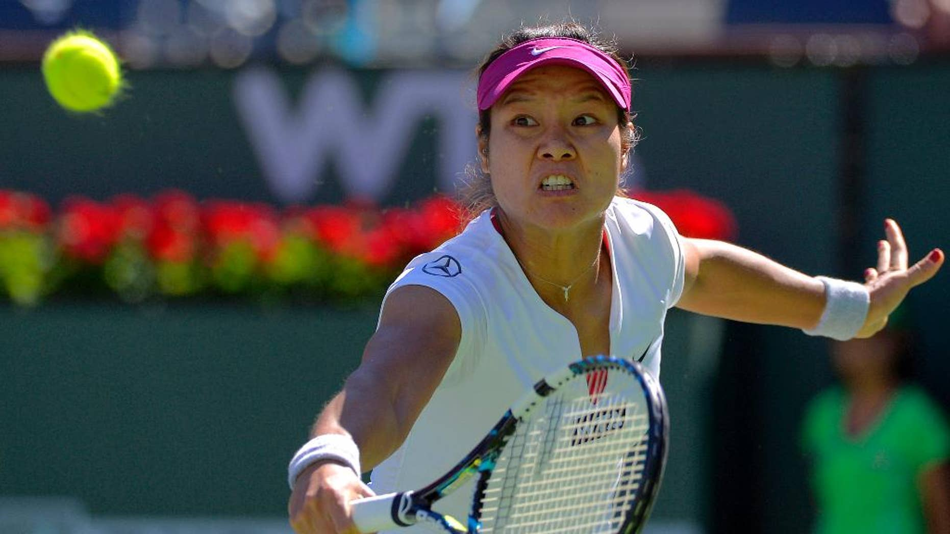 Li Na, of China, returns a volley by Karolina Pliskova, of the Czech Republic, during a third round match at the BNP Paribas Open tennis tournament, Monday, March 10, 2014 in Indian Wells, Calif. (AP Photo/Mark J. Terrill)