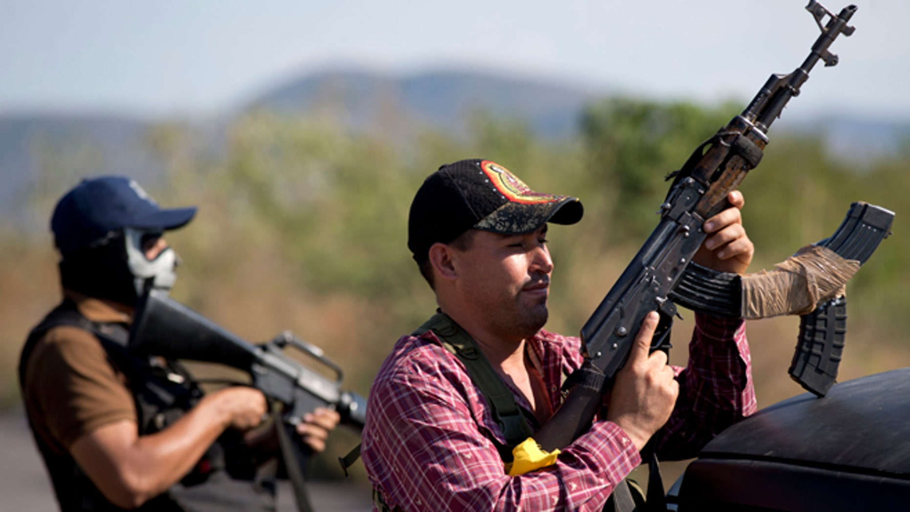 Armed men from the Self-Defense Council of Michoacán at the entrance of Antúnez, Mexico, Jan. 14, 2014.