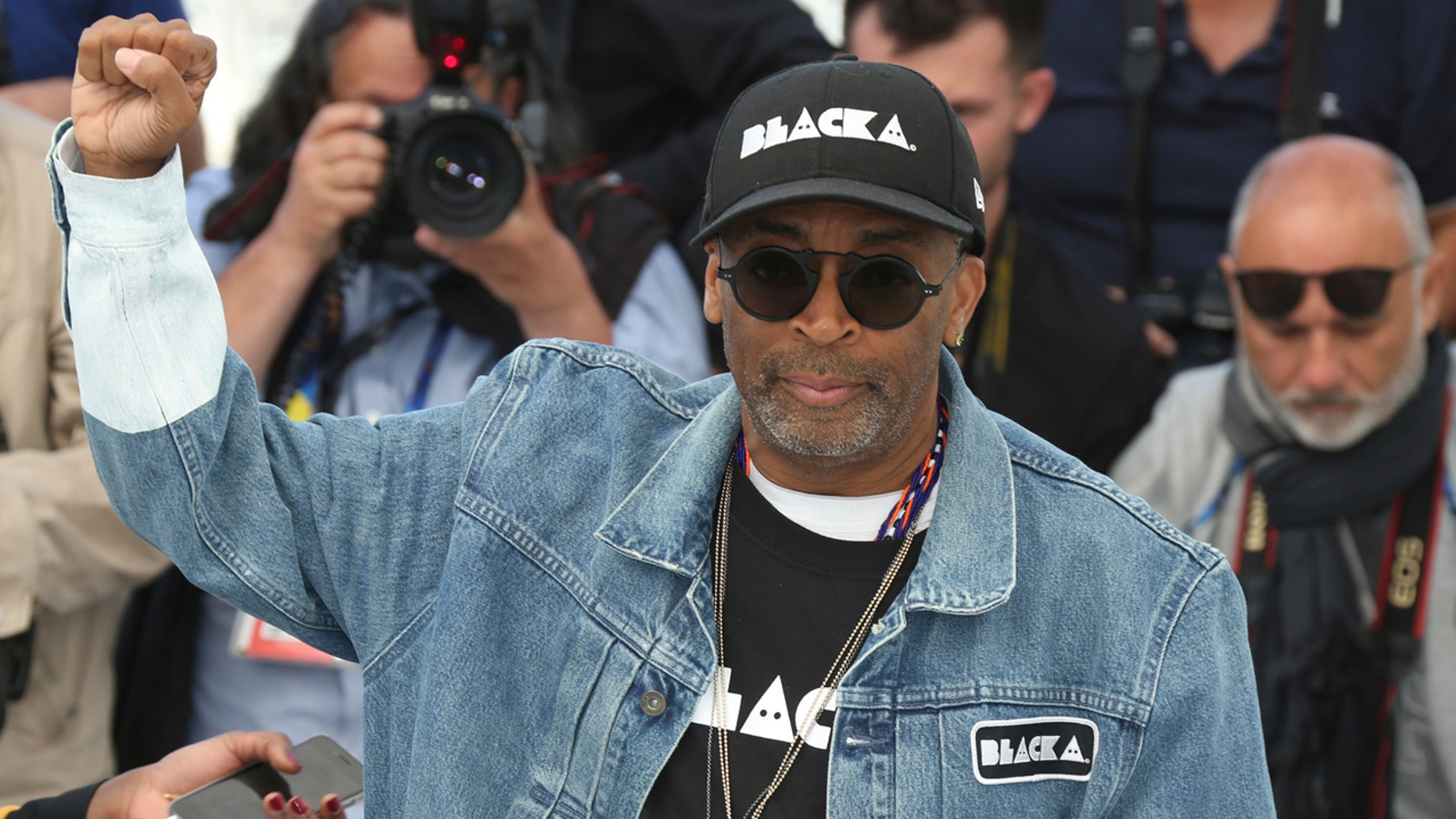 Spike Lee called out President Trump during his speech at the premiere of his new film, 'BlacKkKlansman,' accusing him of mishandling the Charlottesville white supremacy protests.