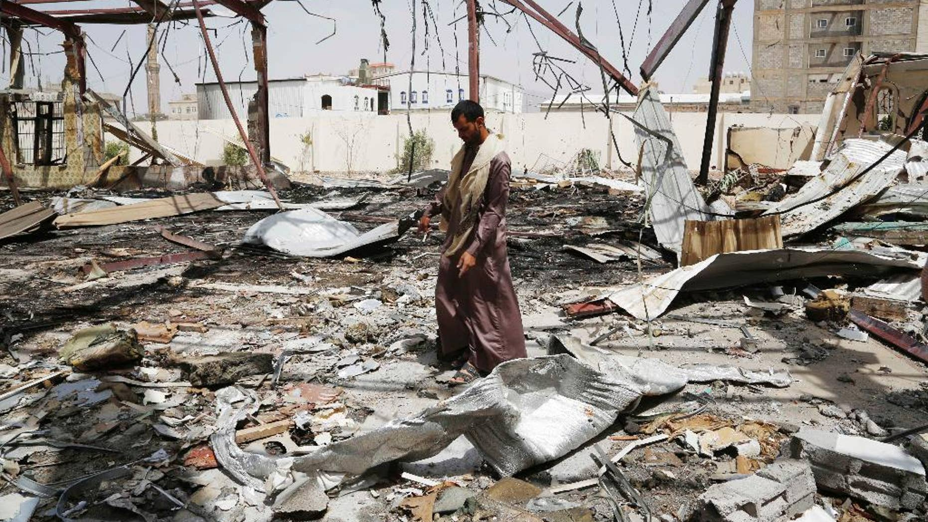 A man stands on the rubble of a wedding hall destroyed by a Saudi-led airstrike in Sanaa, Yemen, Friday, July 10, 2015. More than 3,000 people have been killed since March, when a Saudi-led and U.S.-backed coalition began launching airstrikes against the rebels who seized control of the capital and other cities starting September. (AP Photo/Hani Mohammed)