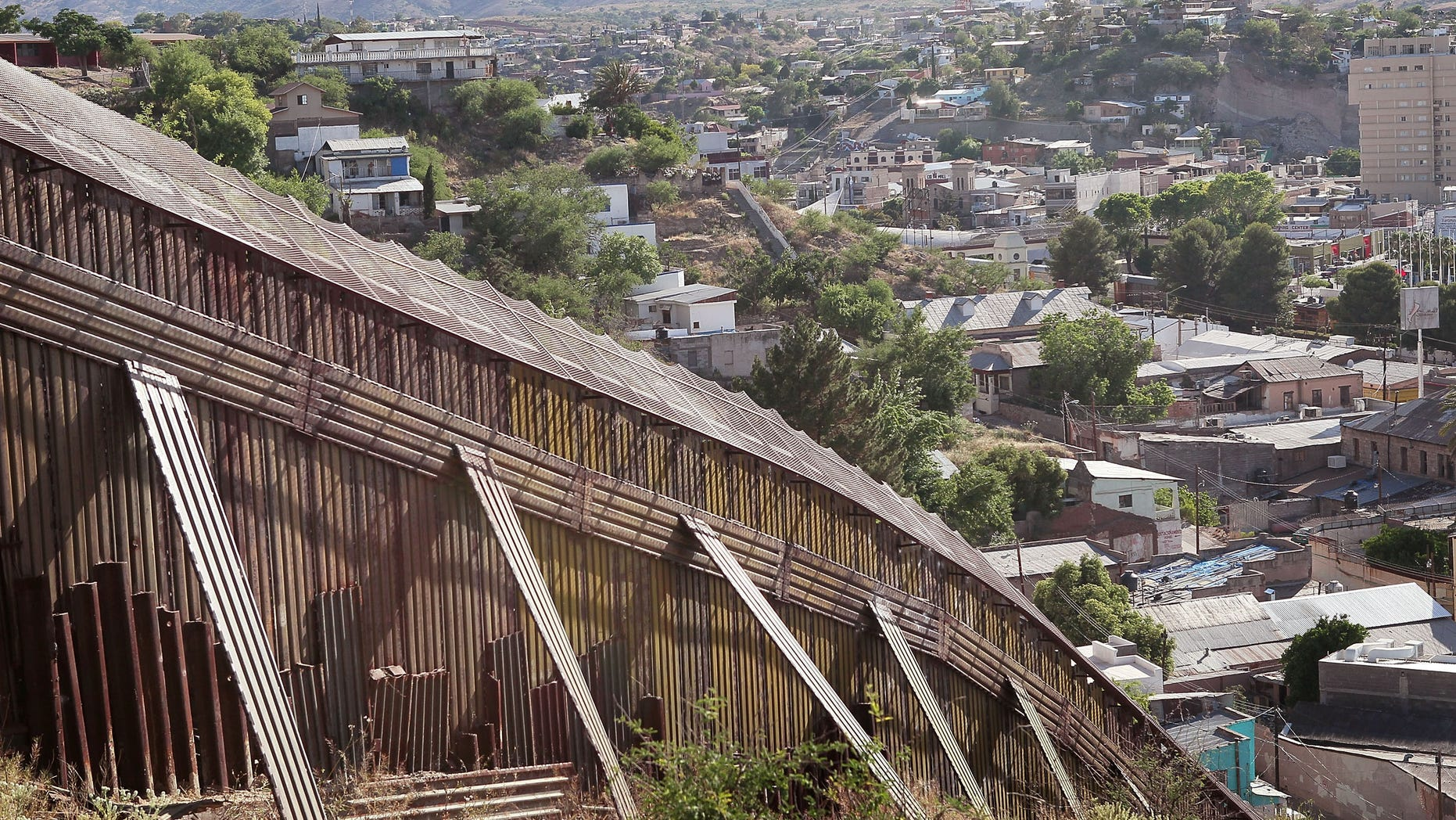 NOGALES, AZ - JUNE 02:  A fence separates the cities of Nogales, Arizona and Nogales, Sonora Mexico, a frequent crossing point for people entering the United States illegally, June 2, 2010 in Nogales, Arizona.  During the 2009 fiscal year 540,865 undocumented immigrants were apprehended entering the United States illegally along the Mexican border, 241,000 of those were captured in the 262 mile stretch of the border known as the Tucson Sector.  (Photo by Scott Olson/Getty Images)