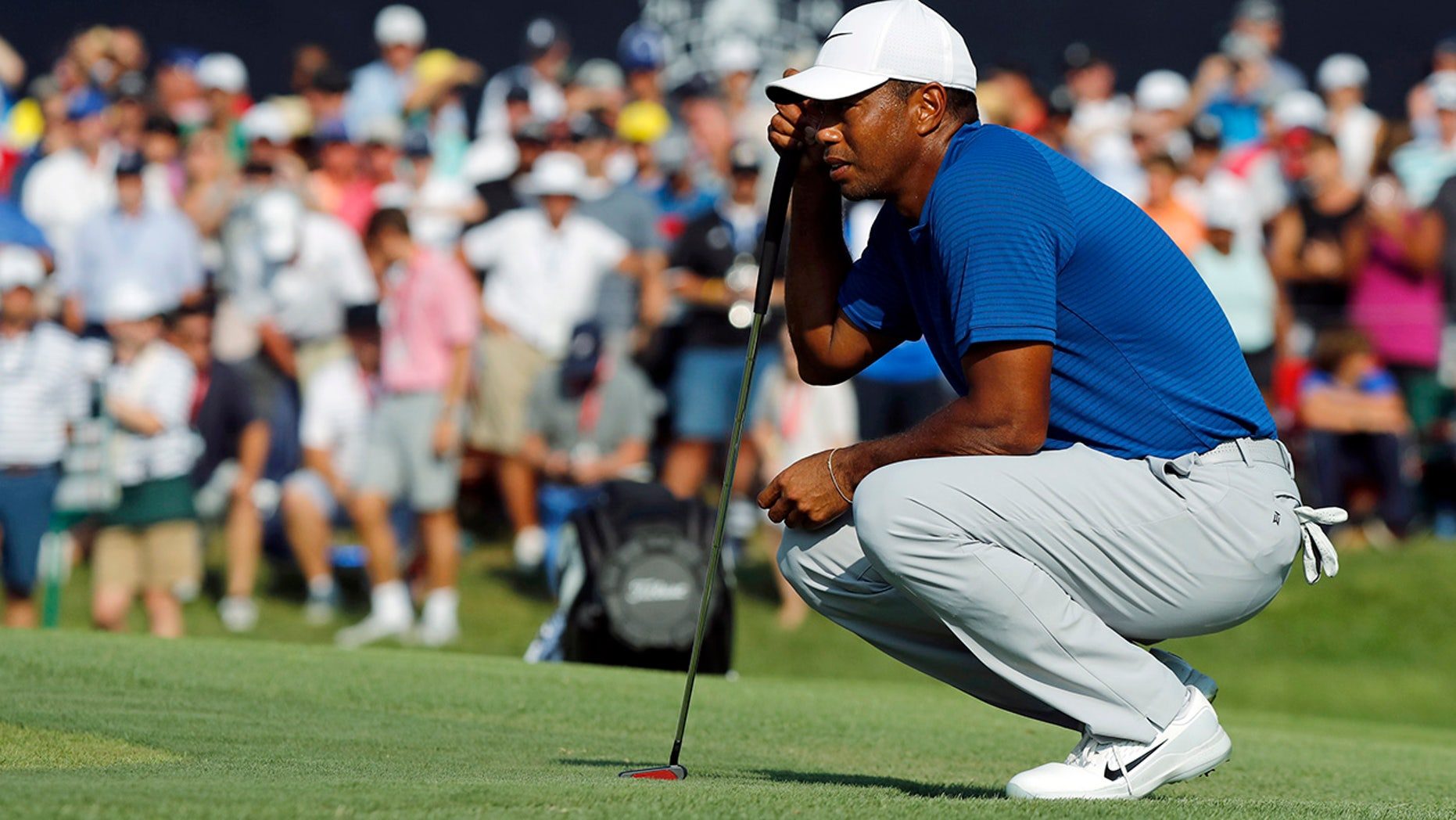 Tiger Woods looks at his putt on the 18th green during the third round of the PGA Championship golf tournament at Bellerive Country Club, St. Luois, Aug. 11, 2018.