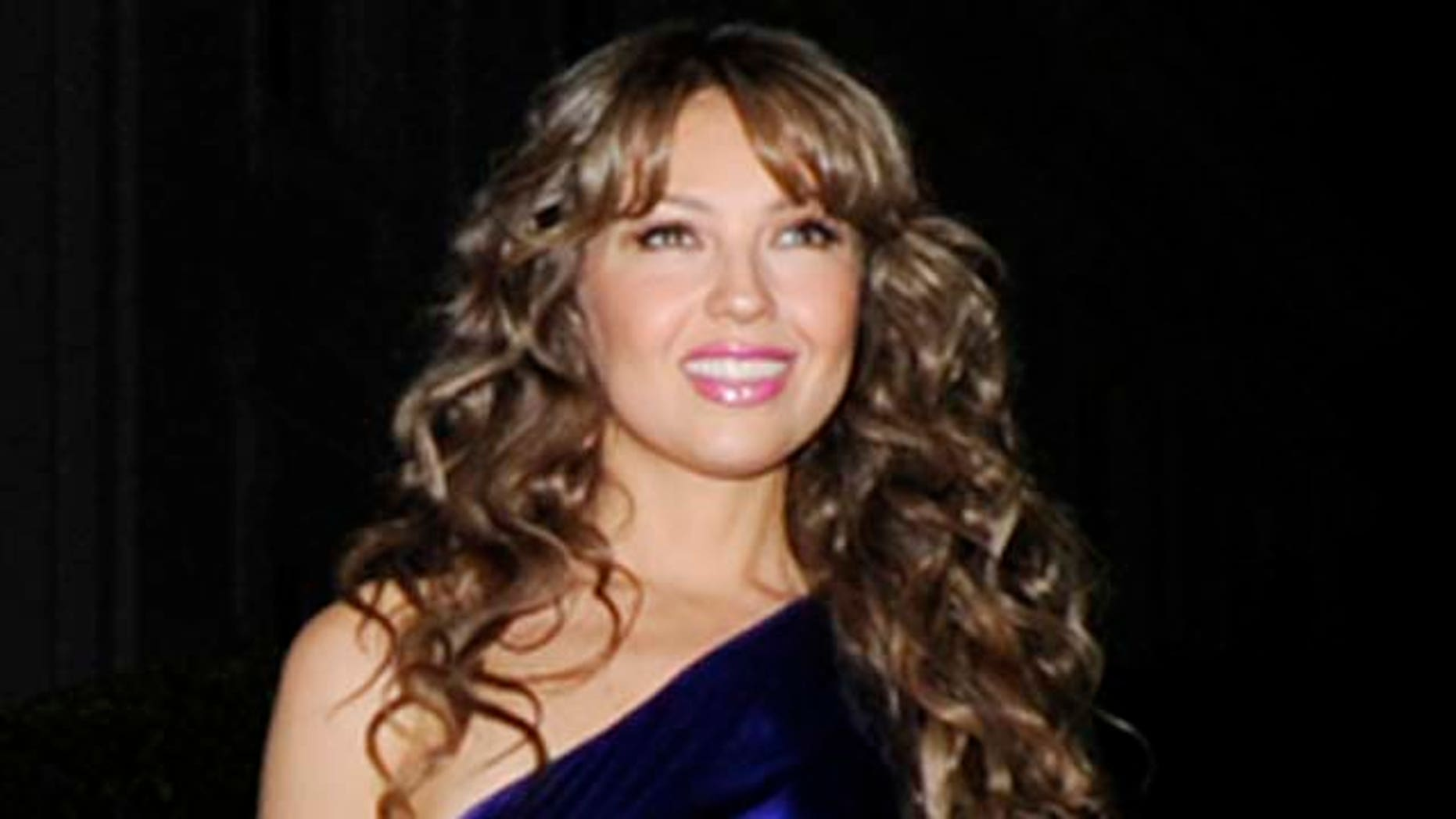 October 13, 2009:  Thalía attends the White House music series 'Fiesta Latina' on the South Lawn of the White House  in Washington, DC.