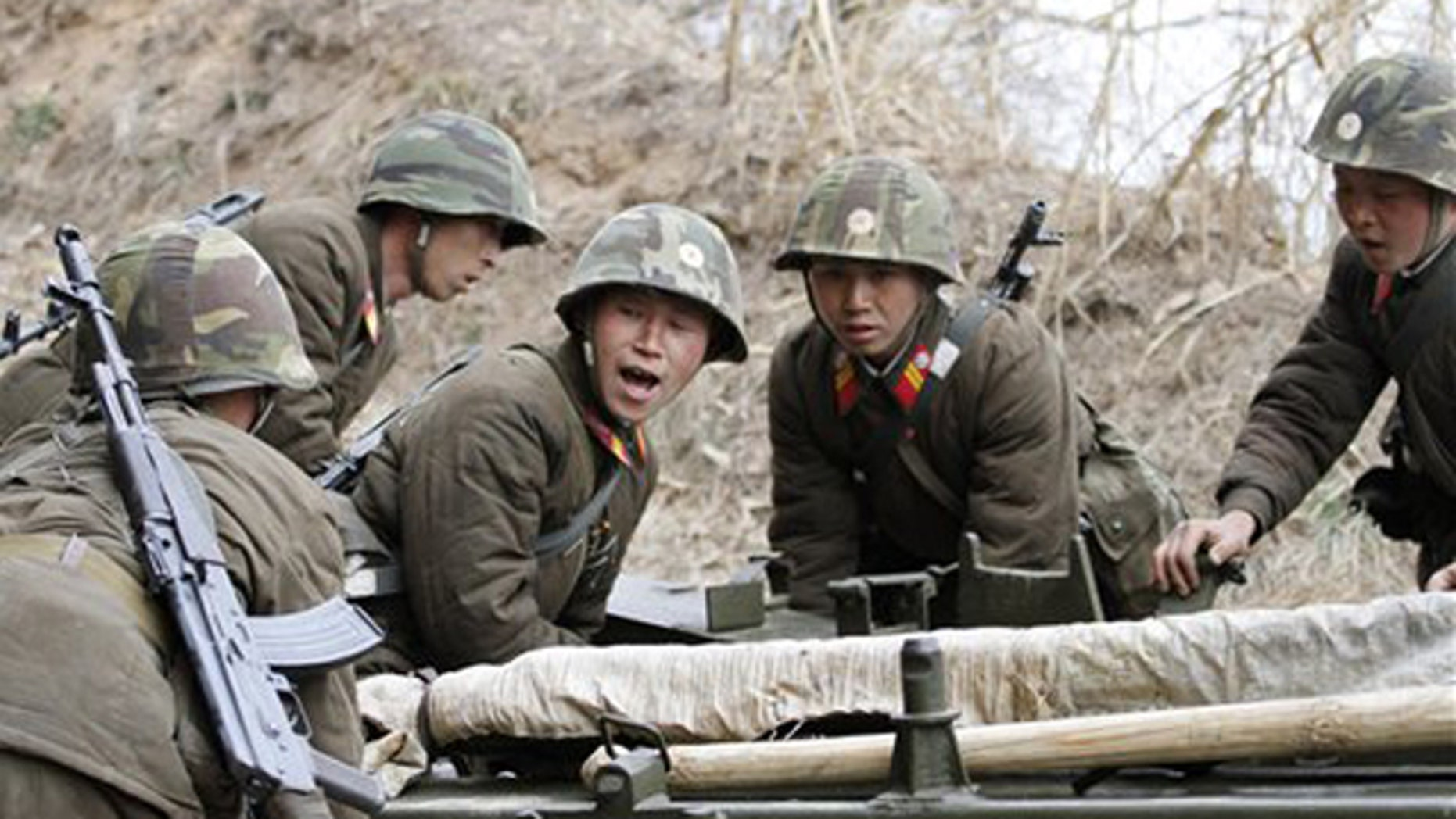 Mar. 5, 2012: North Korean soldiers move equipment during military exercises at a military base on North Korea's southwest coast.