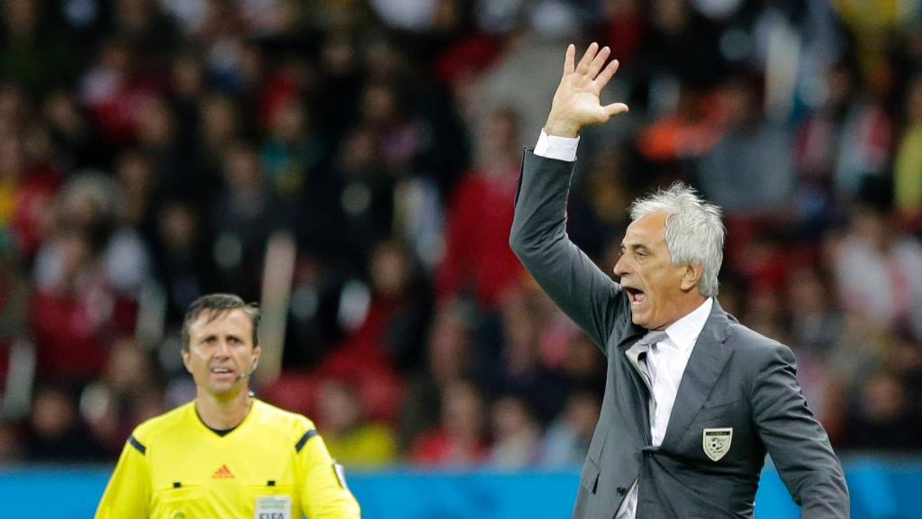 Algeria's head coach Vahid Halilhodzic yells from the sidelines during the World Cup round of 16 soccer match between Germany and Algeria at the Estadio Beira-Rio in Porto Alegre, Brazil, Monday, June 30, 2014. (AP Photo/Matthias Schrader)