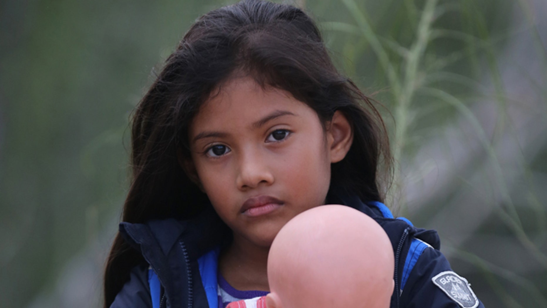 Salvadorian Stefany Marjorie, 8, after crossing the Rio Grande from Mexico on July 24, 2014 near Mission, Texas.