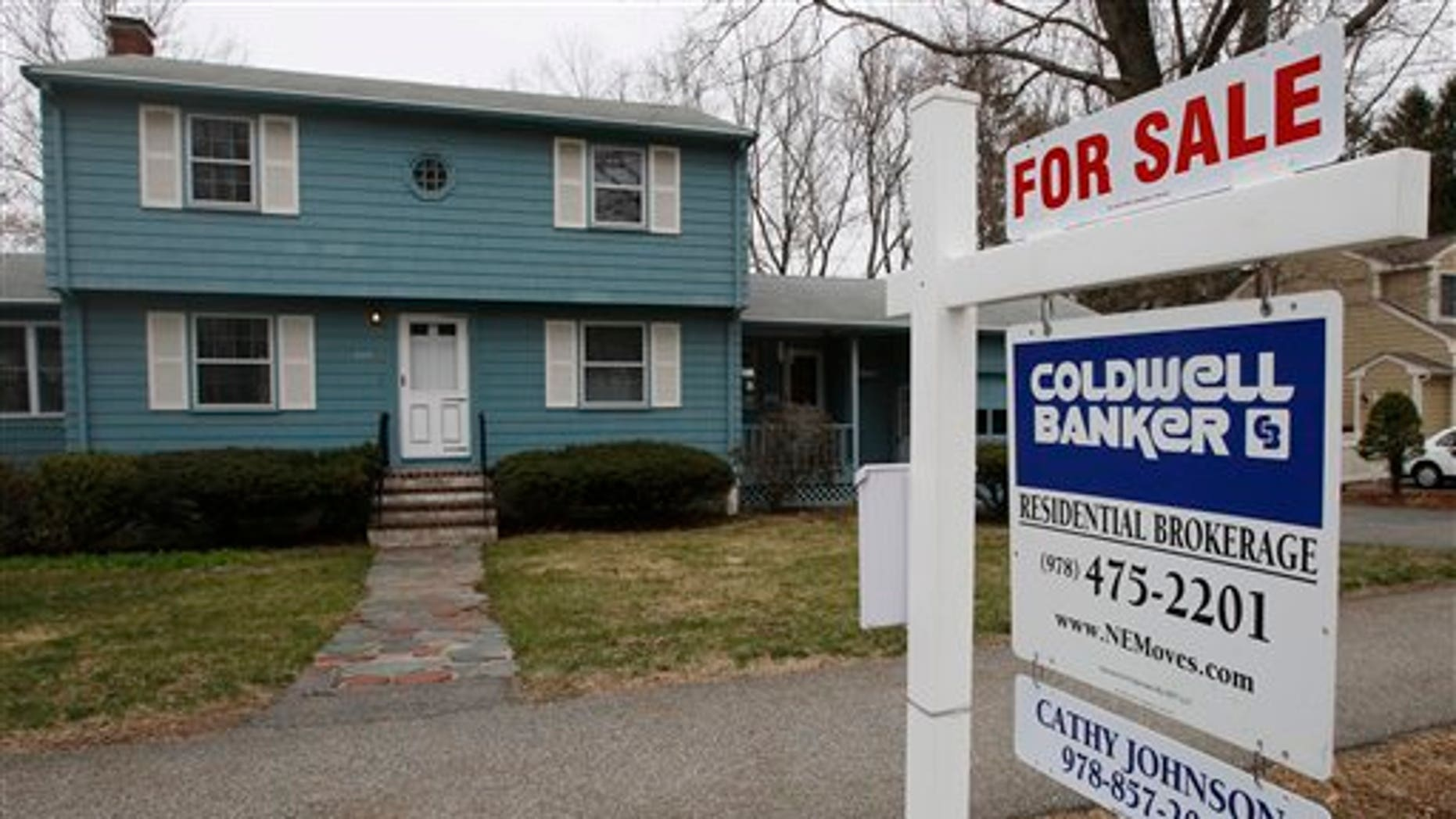 In this April 12, 2011 photo, an existing home is posted for sale in North Andover, Mass. Sales of existing-home sales rose in March, continuing an uneven recovery that began after sales bottomed last July, according to the National Association of Realtors. (AP Photo/Charles Krupa)