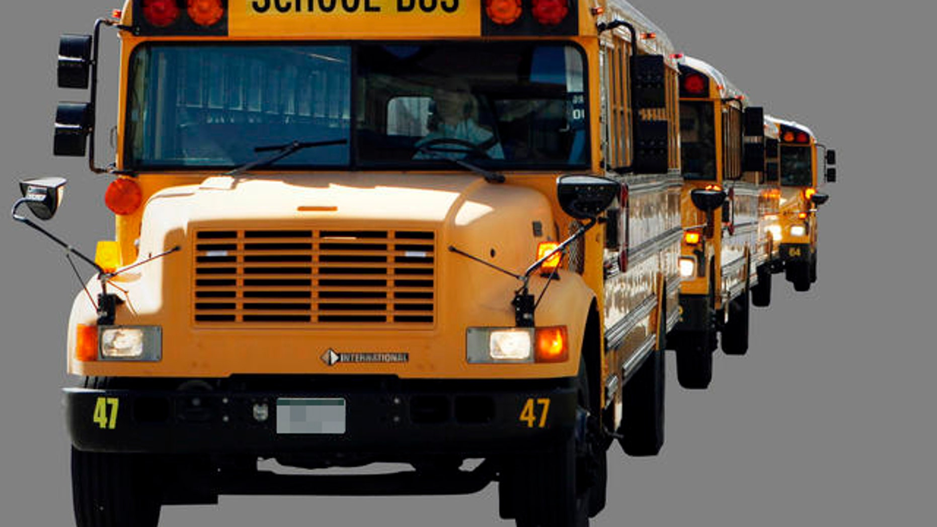 """About 50 buses from Falcon School District 49 circled the state Capitol on Thursday March 31, 2011, with messages for lawmakers considering cutting education funding. The messages included """"NO CUTS"""" and """"DRIVING OUR FUTURE."""" (AP Photo/Ed Andrieski)"""
