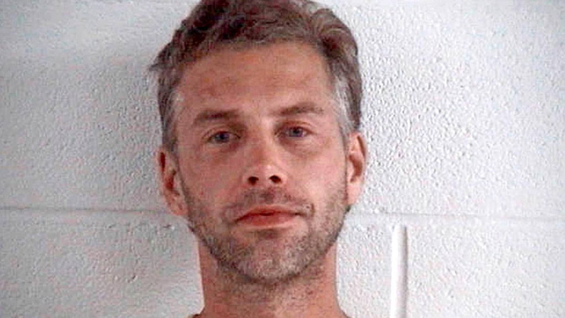 FILE – This file photo provided by the Ashland County Sheriff Office shows Shawn Grate, arrested Sept. 13, 2016, in Ashland, Ohio. Grate, a man linked to the killings of at least four women in Ohio, is due back in court. He is scheduled to appear at a pre-trial hearing on Monday, Oct. 31, in Ashland. (Ashland County Sheriff Office via AP, File)