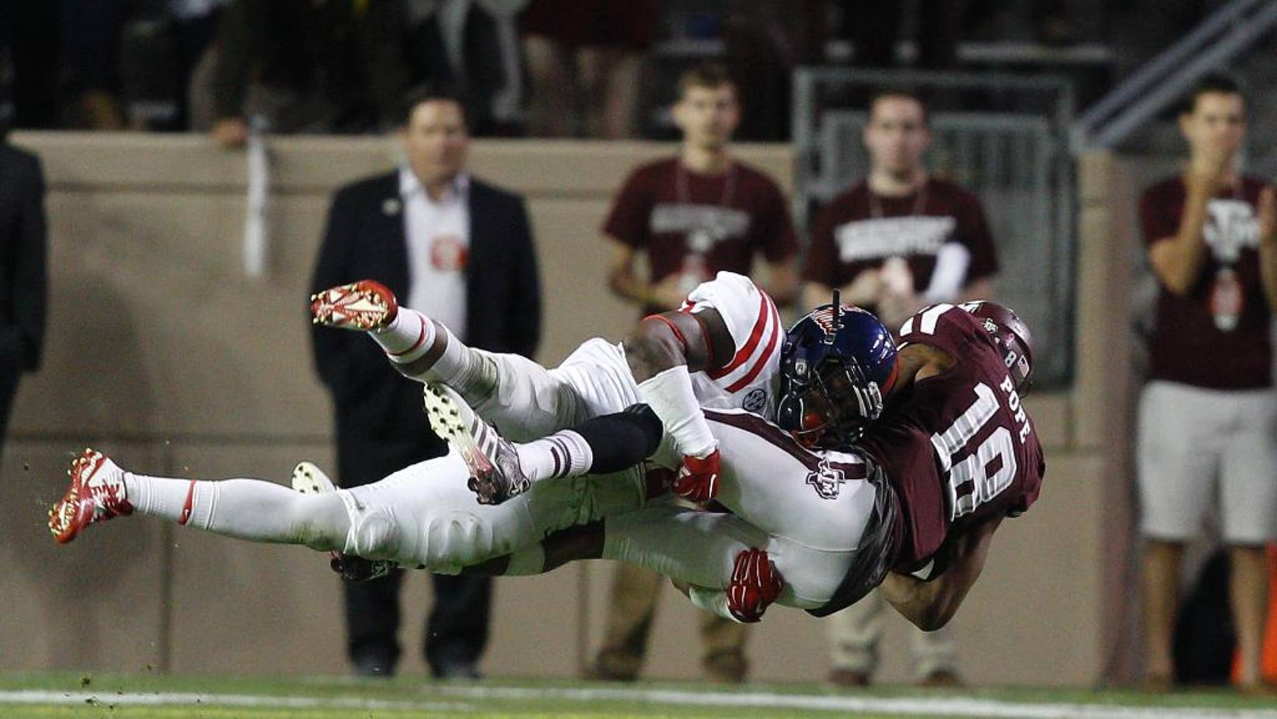 Texas A&M wide receiver Edward Pope (18) is tackled by Mississippi defensive back Tony Conner (12) during the third quarter of an NCAA college football game Saturday, Oct. 11,  2014, in College Station, Texas. (AP Photo/Bob Levey)
