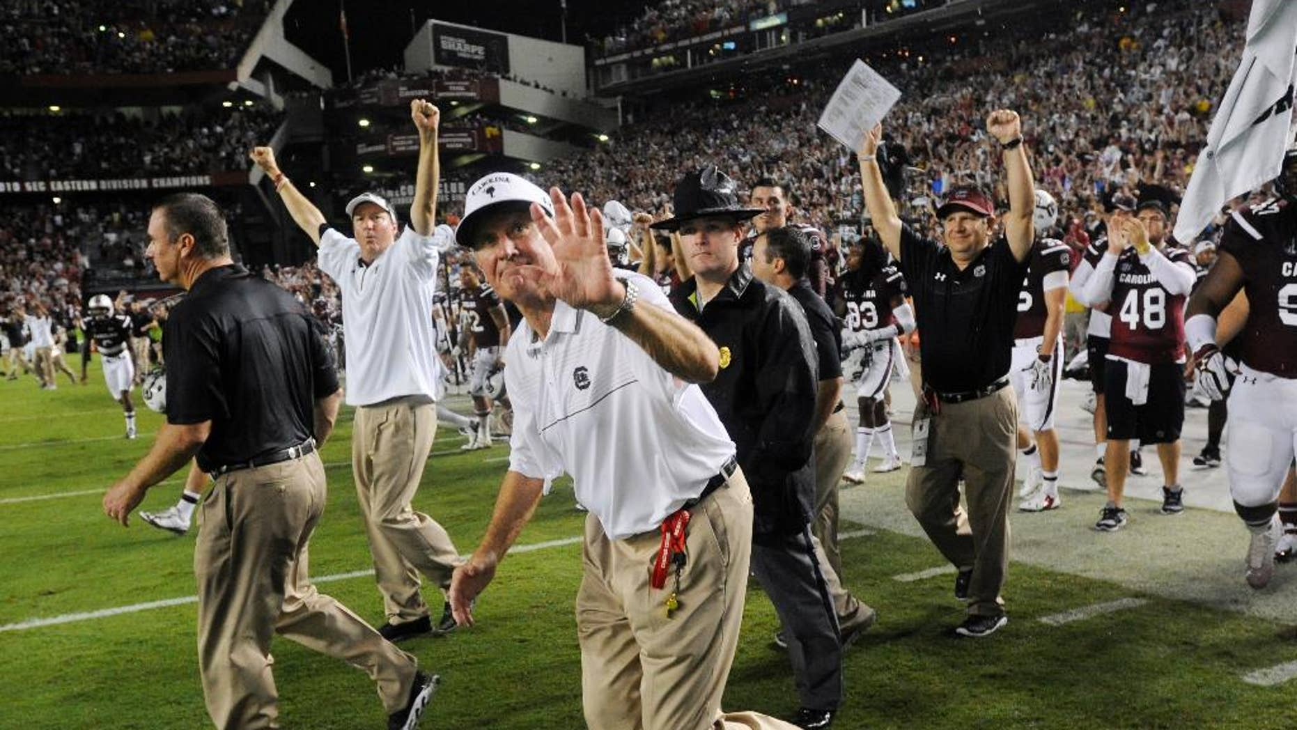 South Carolina head coach Steve Spurrier waves to fans after defeating Georgia 38-35 in an NCAA college football game on Saturday, Sept. 13, 2014, in Columbia, S.C. (AP Photo/Rainier Ehrhardt)