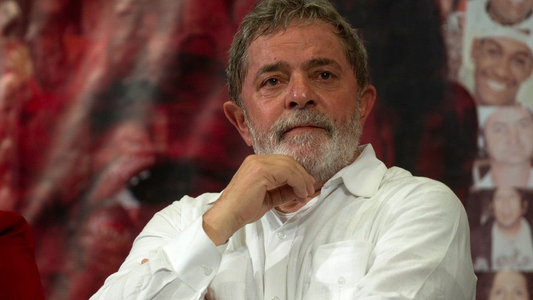 FILE -  In this Dec. 23, 2010 file photo, Brazil's President Luiz Inacio Lula da Silva attends a meeting in Sao Paulo, Brazil. Doctors say the former Brazilian president has a tumor in his larynx. Sao Paulo's Sirio Libanes Hospital say in a statement that the tumor was detected Saturday during exams conducted on Silva. The statement says the former president will undergo chemotherapy treatment starting next week. (AP Photo/Andre Penner)