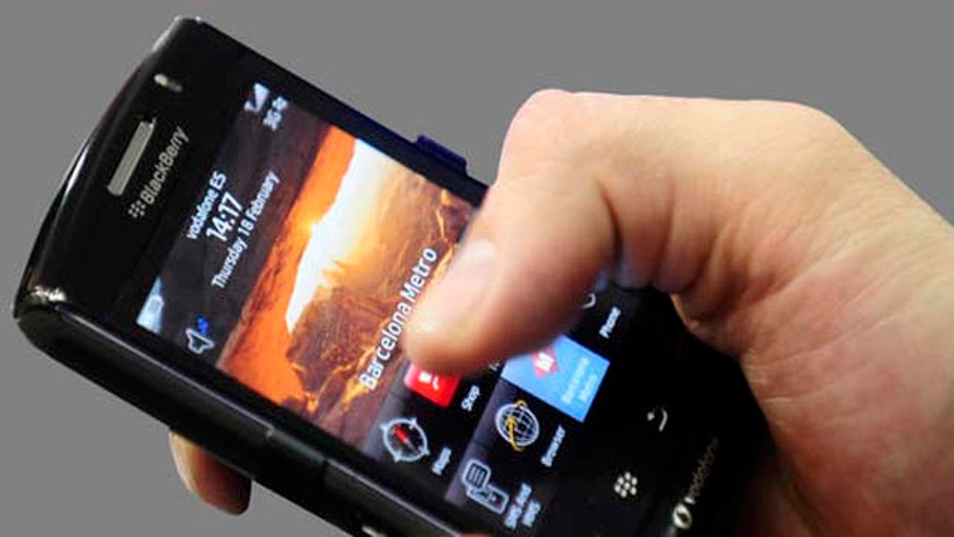 In this Feb. 18, 2010 photo, a BlackBerry Storm2 smartphone is displayed at the Mobile World congress in Barcelona, Spain. BlackBerry maker Research In Motion reports quarterly financial results Wednesday, March 31, 2010. (AP Photo/Manu Fernandez)