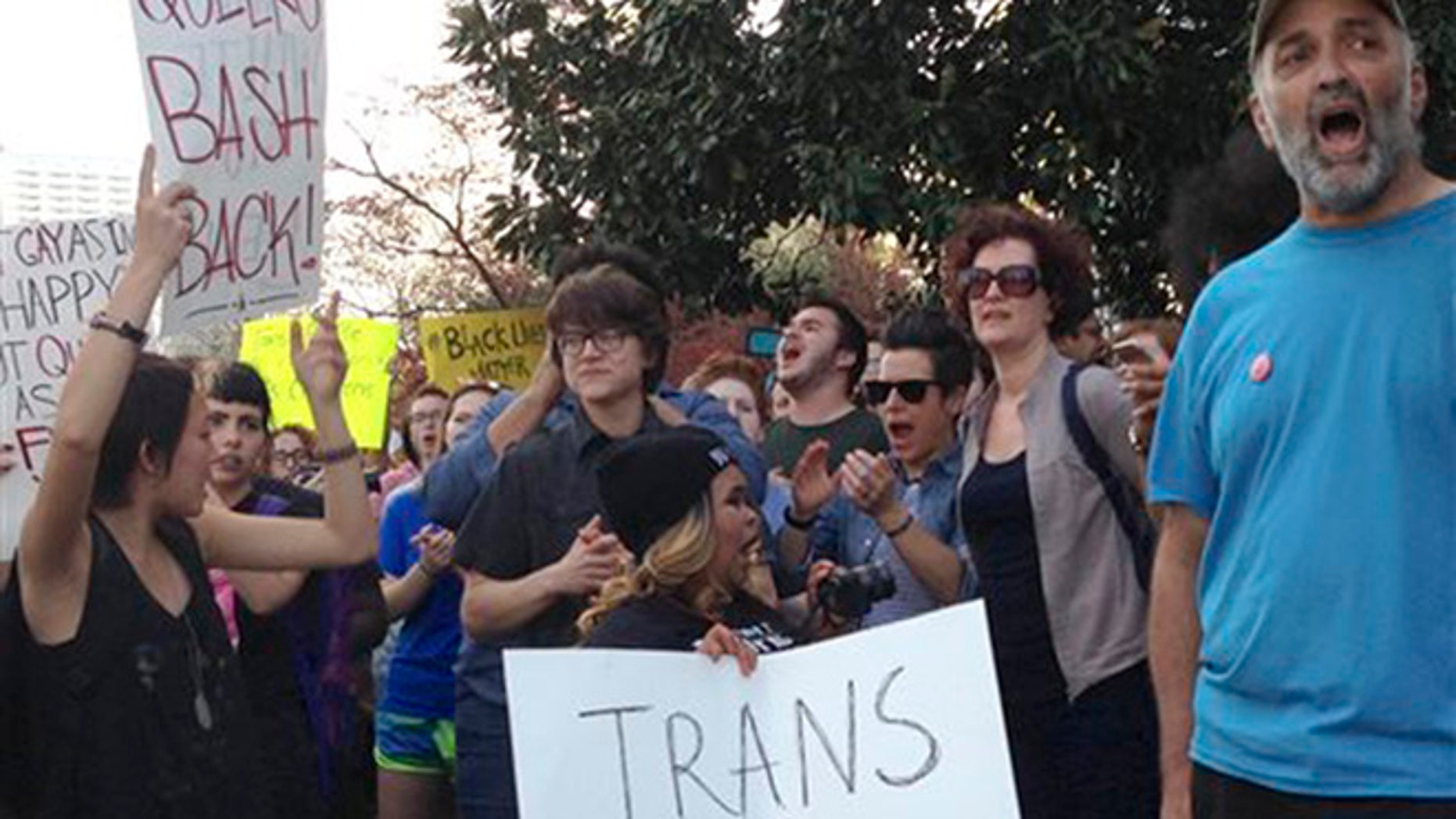 People protest outside the North Carolina Executive Mansion in Raleigh, N.C., Thursday, March 24, 2016. North Carolina legislators decided to rein in local governments by approving a bill Wednesday that prevents cities and counties from passing their own anti-discrimination rules. North Carolina Gov. Pat McCrory later signed the legislation, which dealt a blow to the LGBT movement after success with protections in cities across the country. (AP Photo/Emery P. Dalesio)