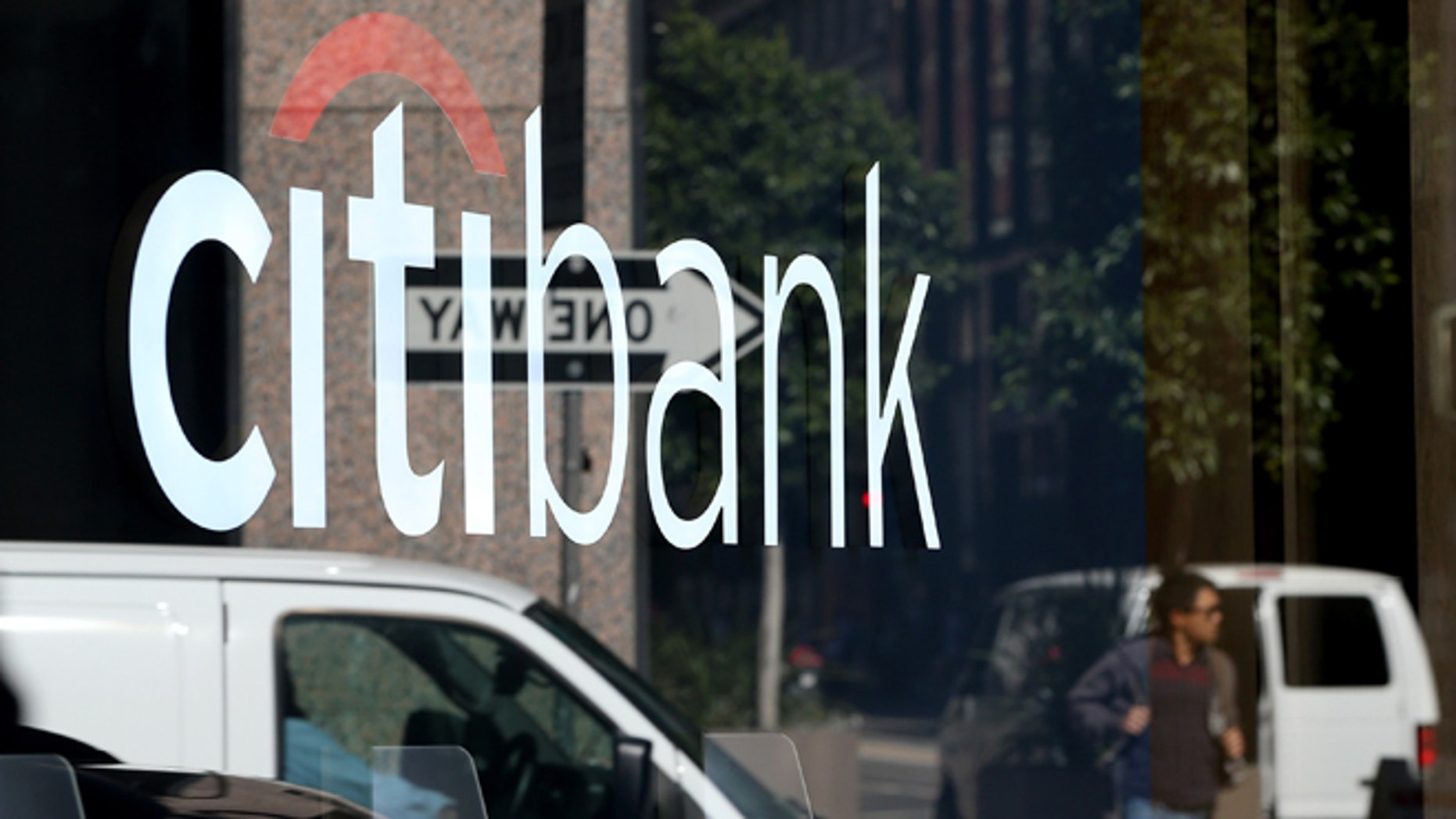 SAN FRANCISCO, CA - JULY 14:  A person is reflected in the window of a Citibank branch office on July 14, 2014 in San Francisco, California.  After several months of negotiations with the U.S. Department of Justice, Citigroup has agreed to pay nearly $7 billion in fines for misleading investors about the quality of mortgage-backed securities prior to the 2008 financial crisis. As part of the settlement Citigroup will pay $2.5 billion in consumer relief.  (Photo by Justin Sullivan/Getty Images)