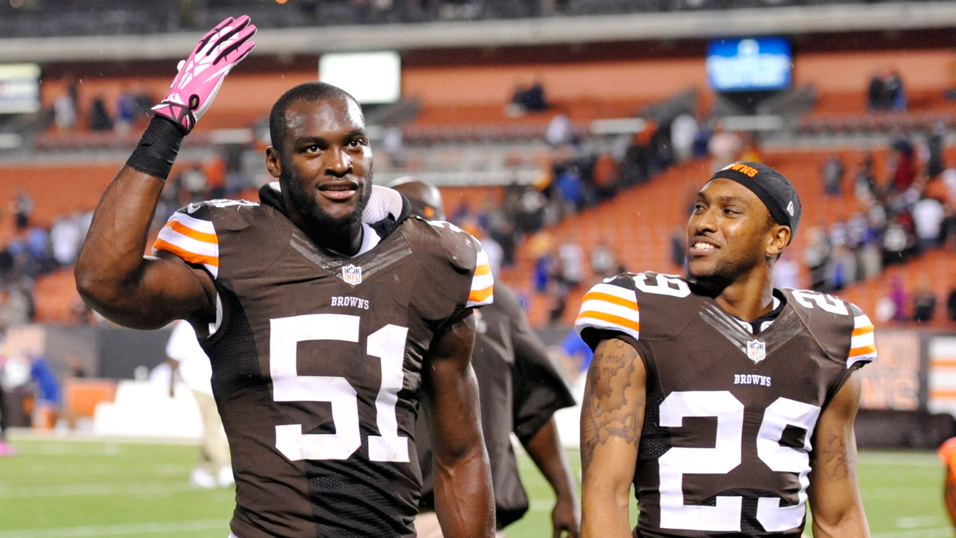 Cleveland Browns outside linebacker Barkevious Mingo (51) and cornerback Leon McFadden (29) celebrate after a 37-24 win over the Buffalo Bills in an NFL football game Thursday, Oct. 3, 2013, in Cleveland. (AP Photo/David Richard)