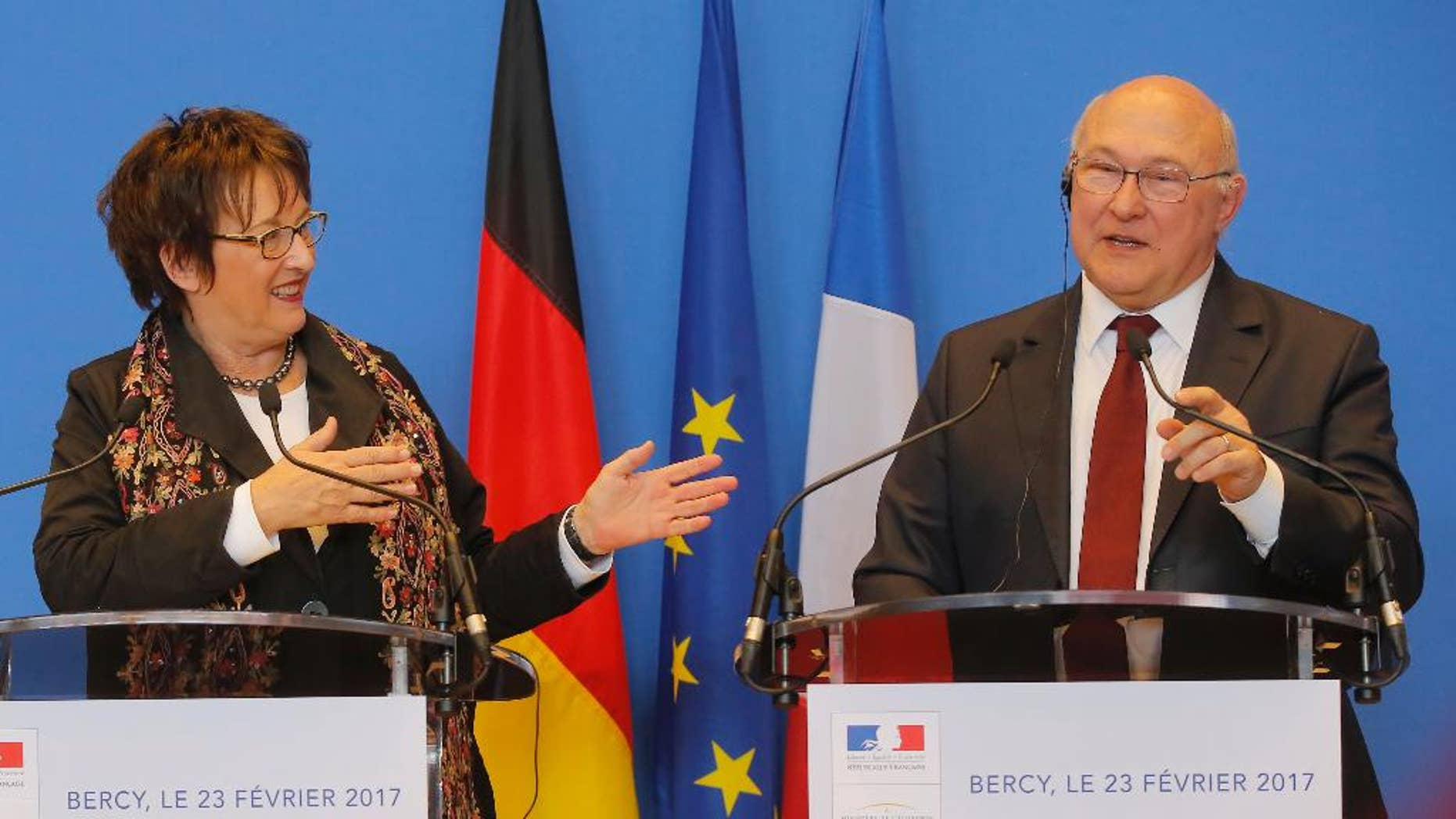 Germany's Economic Affaire and Energy Minister Brigitte Zypries, left, and France's Finance Minister Michel Sapin attend a media conference at the ministry in Paris, Thursday, Feb. 23, 2017. France's Finance Minister Michel Sapin and his Germany's Economy Affair and Energy Minister Brigitte Zypries discussed during their meeting the future of General Motors' Opel subsidiary. (AP Photo/Michel Euler)