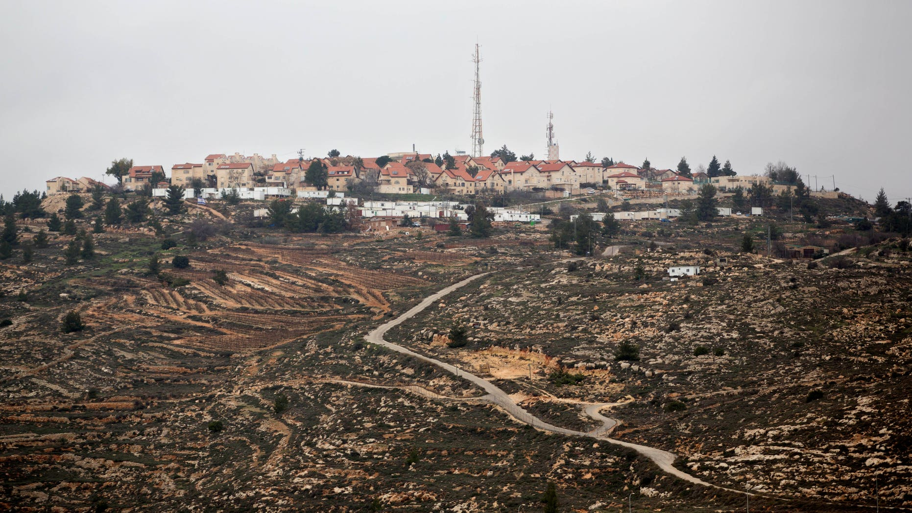 """A general view of the West Bank Jewish settlement of Psagot near Ramallah, Monday, Jan. 27, 2014. The Palestinians' """"extreme and reckless"""" rejection of an Israeli suggestion that some Jewish settlers remain in a future Palestinian state proves that they don't want peace, Prime Minister Benjamin Netanyahu's office said Monday. The harshly worded statement follows a flurry of back-and-forth condemnations sparked by an Associated Press report that Netanyahu believes all Jewish settlers should have the right to remain in their homes in a future Palestine. (AP Photo/Sebastian Scheiner)"""
