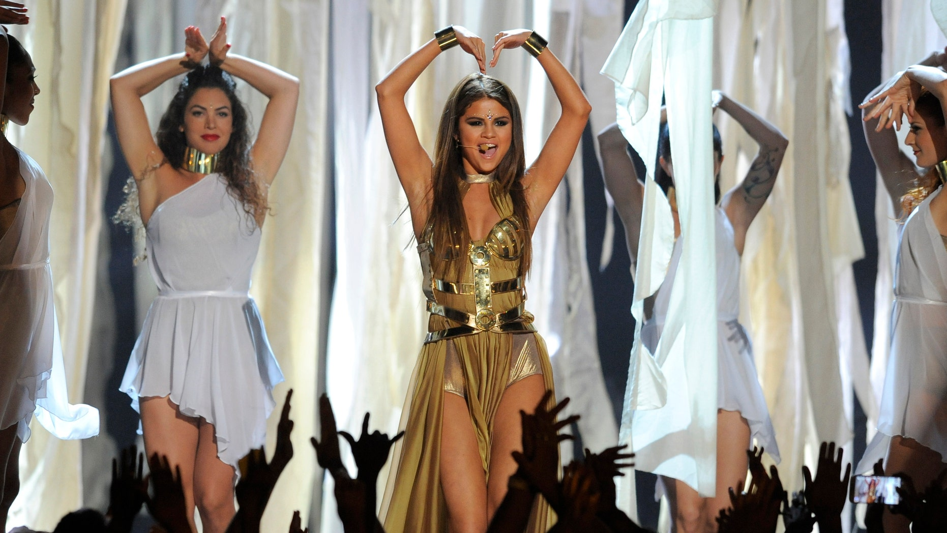 Selena Gomez, center, performs at the Billboard Music Awards at the MGM Grand Garden Arena on Sunday, May 19, 2013 in Las Vegas. (Photo by Chris Pizzello/Invision/AP)