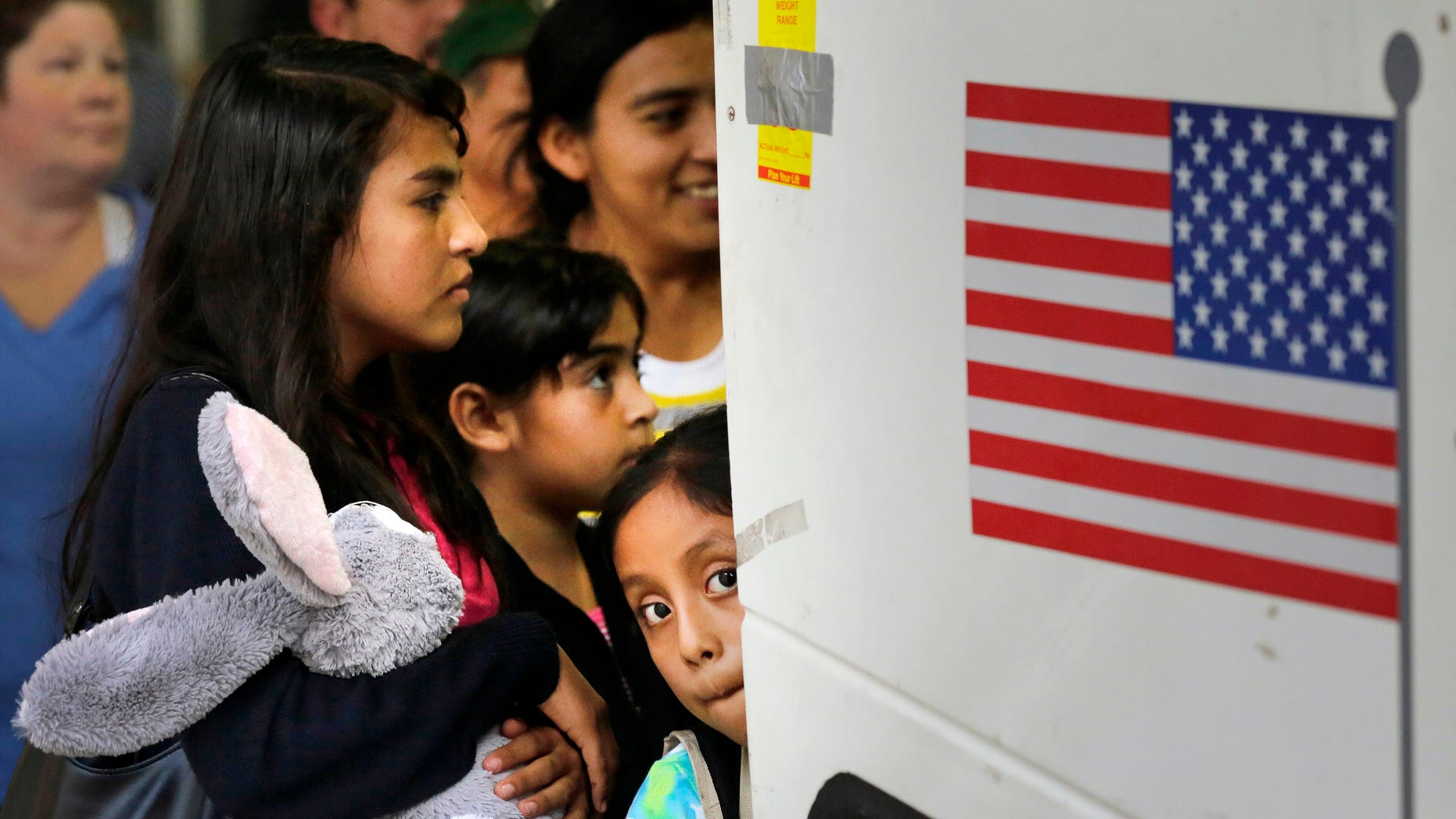 Immigrants from El Salvador and Guatemala board a bus on July 7, 2015.