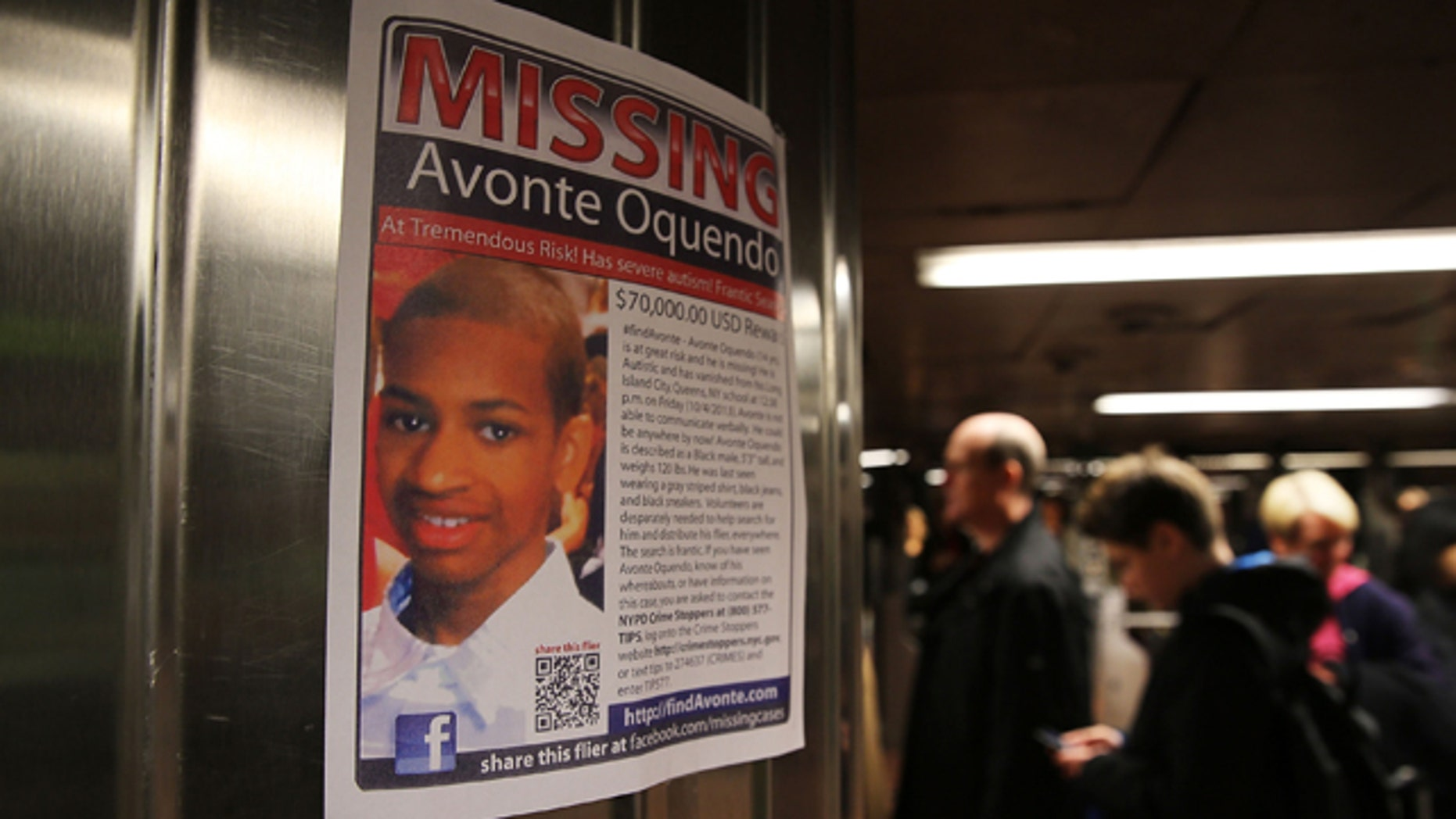 A poster for a missing autistic 14-year-old named Avonte Oquendo hangs in subway station on October 21, 2013 in New York City.