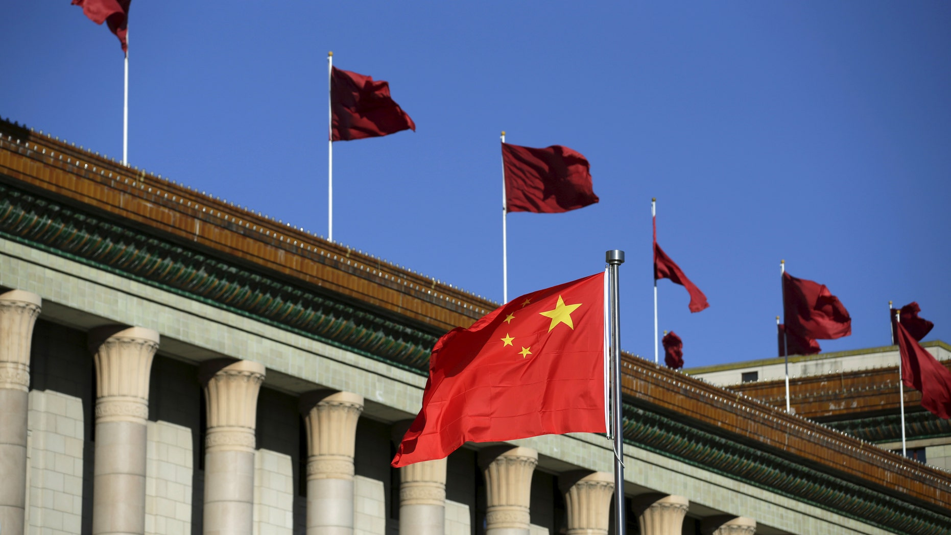 Chinese flag waves in front of the Great Hall of the People in Beijing, China, October 29, 2015. (REUTERS/Jason Lee)