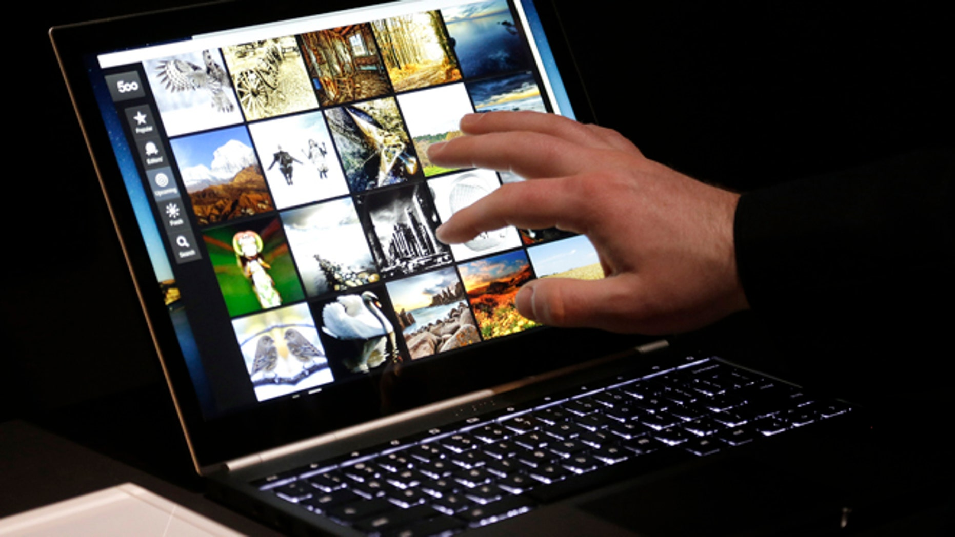 File photo: Feb. 21, 2013: A man uses the Google Chromebook Pixel laptop computer after an announcement in San Francisco.  (AP Photo/Jeff Chiu)