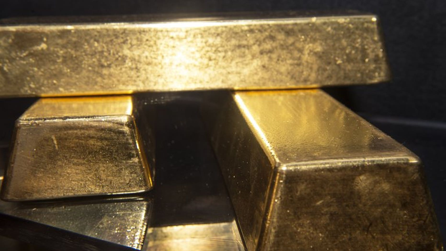 Three gold bullion bars with a combined value of more than $2 million on display at the Bureau of Engraving and Printing in Washington, on August 27, 2012