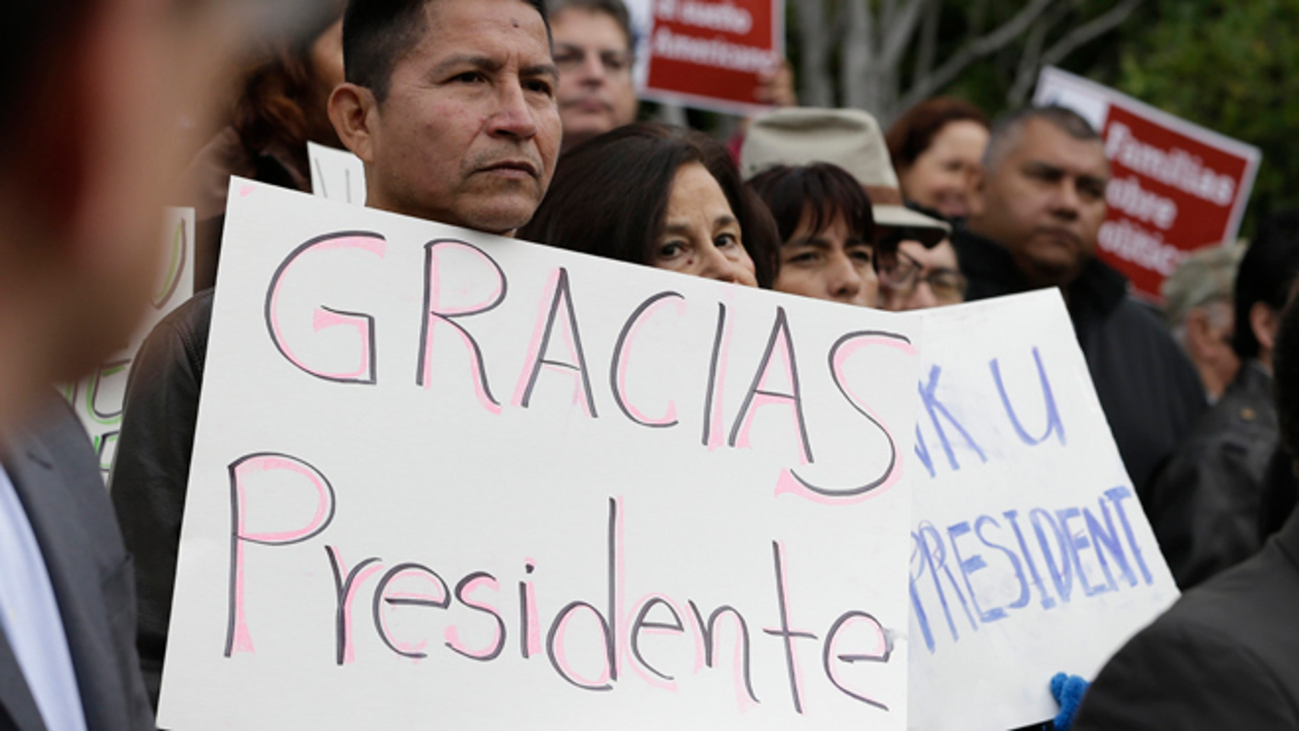 Sebastian Montalvan, left, who has been living in the country illegally, joined dozens of others who are here illegally, as well as activists and supporters to celebrate President Barack  Obama's executive action on illegal immigration, at a at a news conference in Sacramento, Calif., Friday, Nov. 21, 2014.(AP Photo/Rich Pedroncelli)