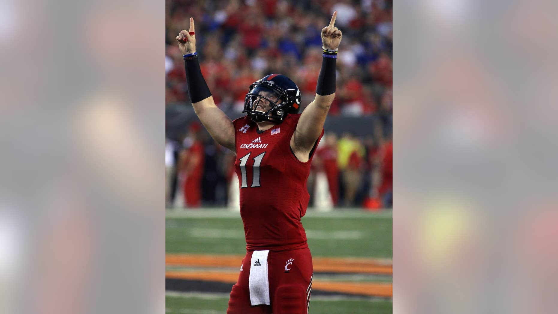 Cincinnati quarterback Gunner Kiel reacts after his team scored against Miami (Ohio) in the first half of an NCAA college football game in Cincinnati, Saturday, Sept. 20, 2014. (AP Photo/Tom Uhlman)