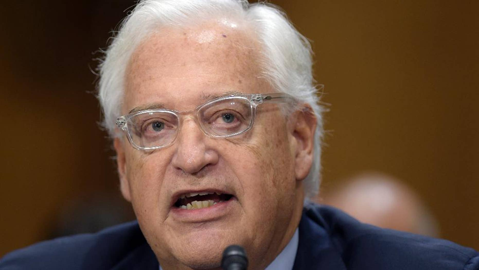 FILE - In this Feb. 16, 2017 file photo, U.S. Ambassador Israel-designate David Friedman testifies on Capitol Hill in Washington at his confirmation hearing before the Senate Foreign Relations Committee. The committee narrowly approved Friedman's nomination, Thursday, March 9, 2017.  (AP Photo/Susan Walsh, File)