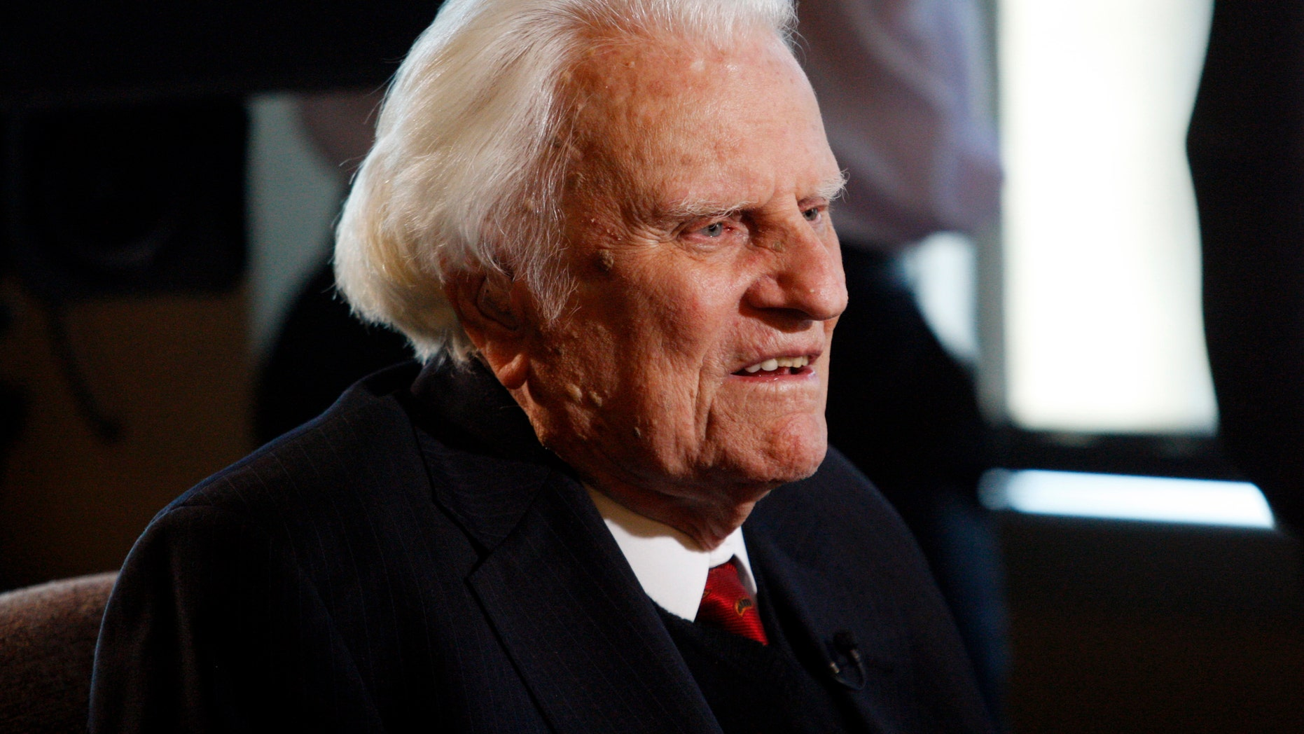 FILE - In this Dec. 20, 2010 file photo, evangelist Billy Graham speaks during an interview at the Billy Graham Evangelistic Association headquarters in Charlotte, N.C. Graham, 95, has returned to his home in Montreat on Thursday, Nov. 21, 2013, after being hospitalized for pulmonary-related tests and observation. (AP Photo/Nell Redmond, File)