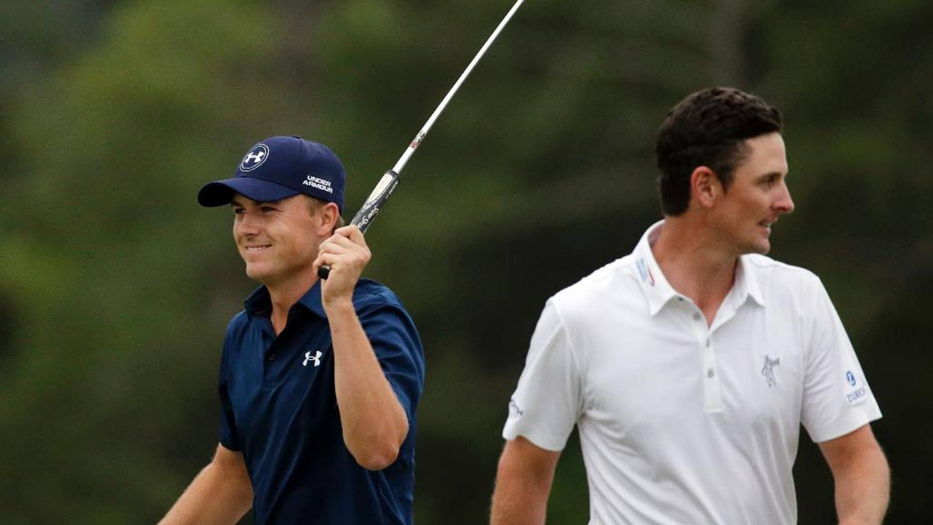 """FILE - In this April 12, 2015, file photo, Jordan Spieth, left, celebrates after winning the Masters golf tournament in Augusta, Ga., as Justin Rose, of England, walks away. Spieth is competing in match play for the second time this month. The first occasion was only in his mind. He was five shots clear of Rose when he made the turn at Augusta National and was trying to keep his mind off the green jacket ceremony. So he told himself he was 1 down to Rose in match play and """"let's play against him and see what we can do to get back."""" (AP Photo/Chris Carlson, File)"""