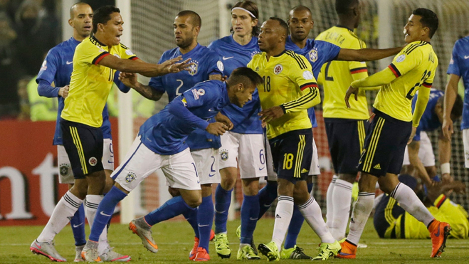 Colombia's Carlos Bacca, second left, pushes Brazil's Neymar, center right, at the end of the Copa America Group C soccer match at the Monumental stadium in Santiago, Chile, Wednesday, June 17, 2015. Colombia  won the match 1-0 and Bacca and Neymar where both sent off with a red card at the end of the match. (AP Photo/Ricardo Mazalan)