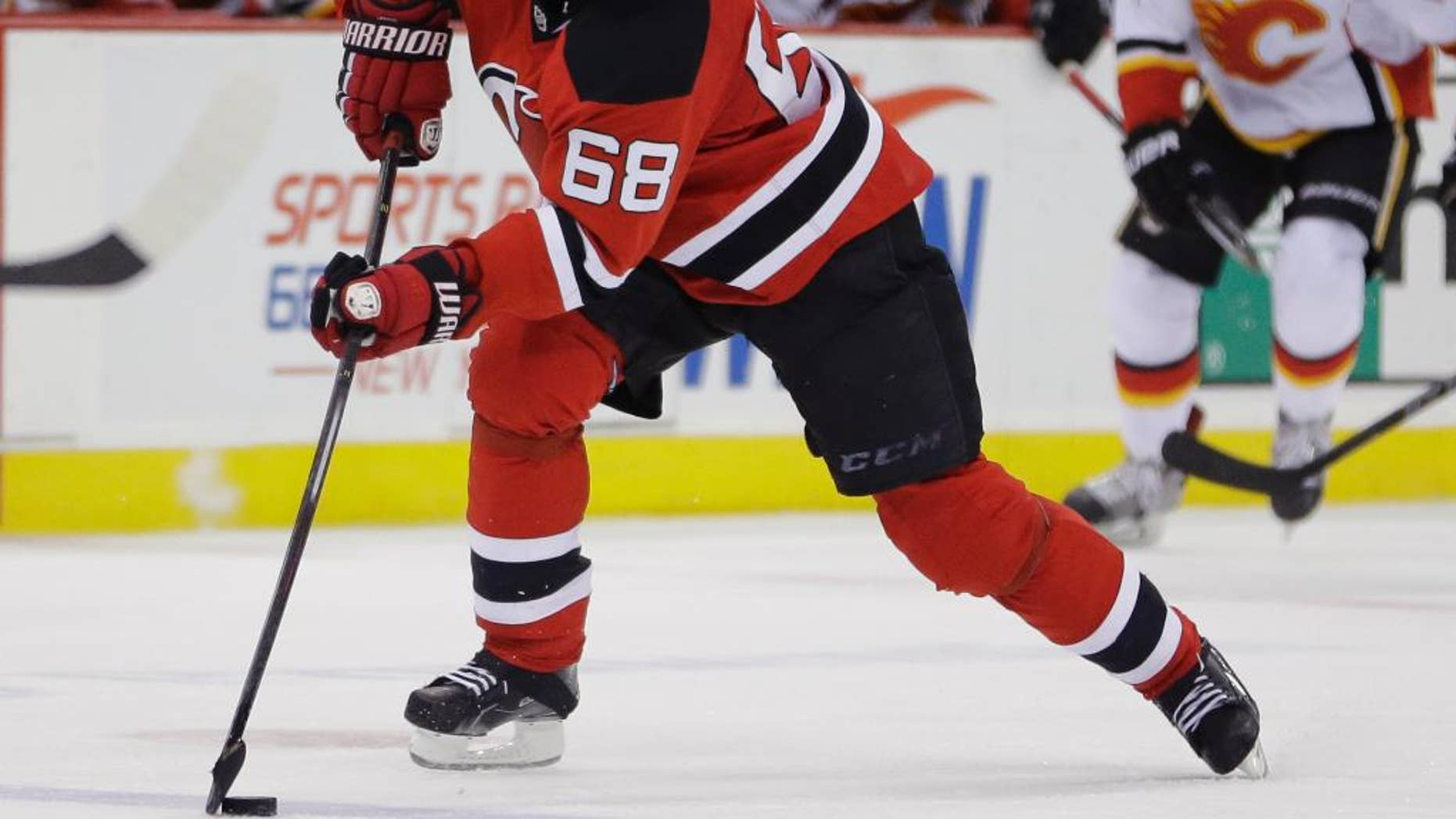 New Jersey Devils right wing Jaromir Jagr, of the Czech Republic, skates against the Calgary Flames during the second period of an NHL hockey game, Wednesday, Feb. 25, 2015, in Newark, N.J. (AP Photo/Julio Cortez)